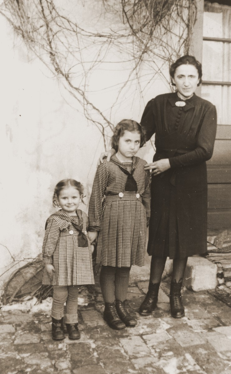 Irene Ripp Keller and her daughters Elvira and Mira in their back yard.