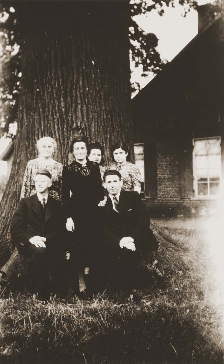 Members of the Zion family pose with one of the Dutch farming families that hid them during the Holocaust.  Among those pictured are Julius Zion (bottom right); Frieda Zion (back row, right); and Mien Zion (back row, second from the right).