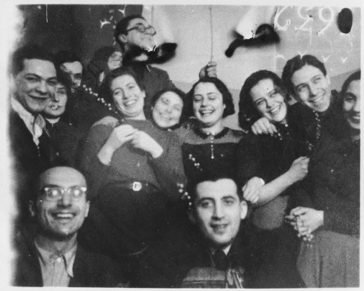 Members of the Hehalutz Zionist youth movement in Berlin celebrate the holiday of Shavuot.  Among those pictured is Jizchak Schwersenz (front row, left).
