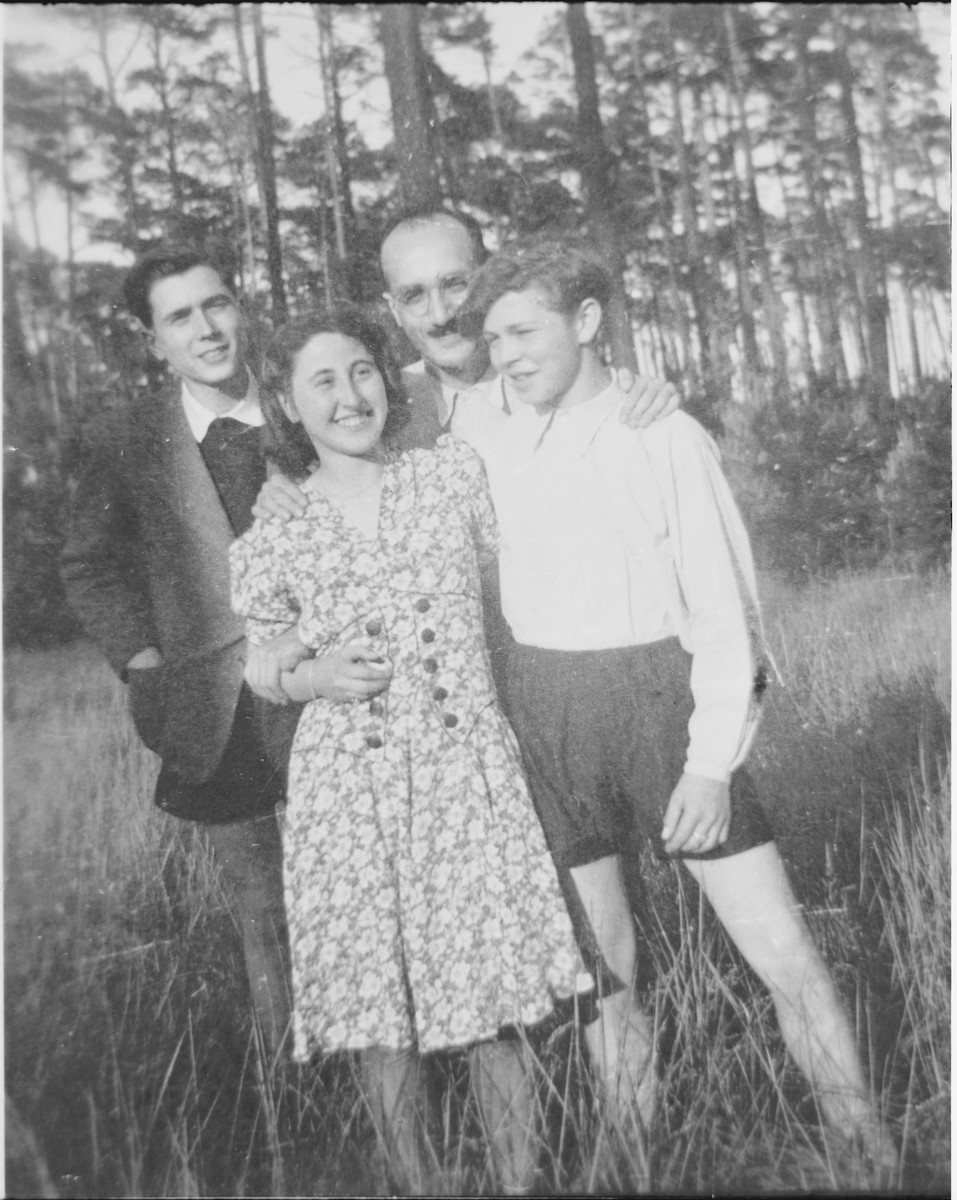 Four members of the Chug Halutzi underground Zionist youth group on a hike in the woods.    Pictured are Leopold (Poldi) Chones (back row, left), Jizchak Schwersenz (back row, right), Margot (Miriam) Beck (front row, left), and David Billard (front row, right).