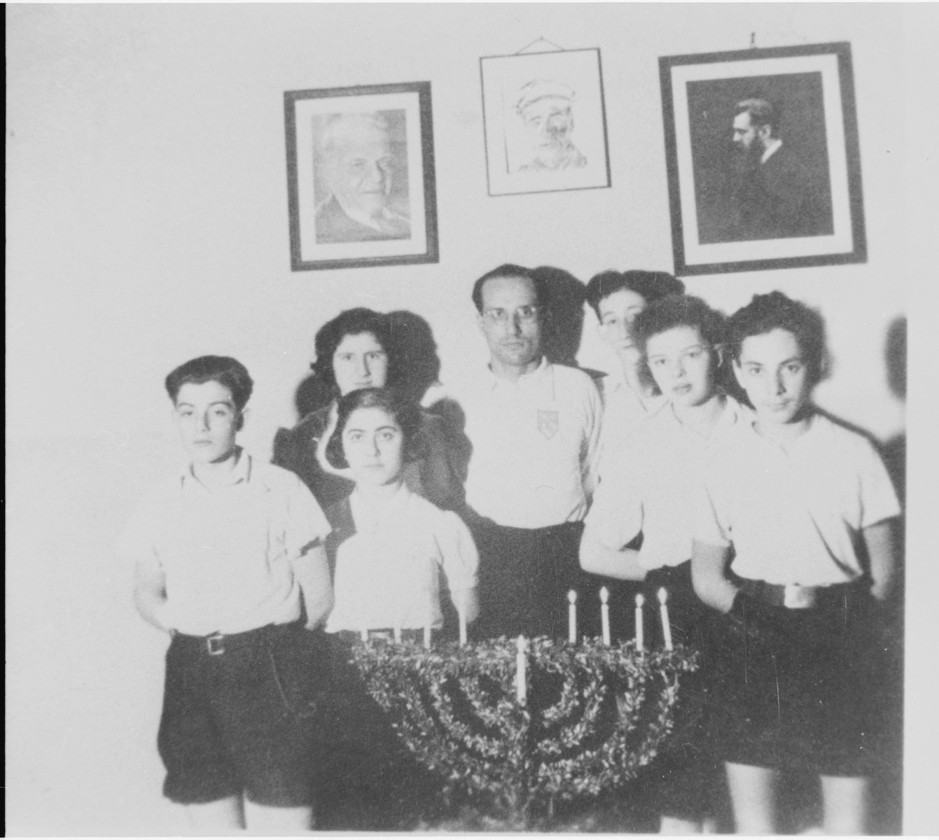 Jizchak Schwersenz (center) poses with some of his students during a Hanukkah celebration at the Youth Aliyah school in Berlin.
