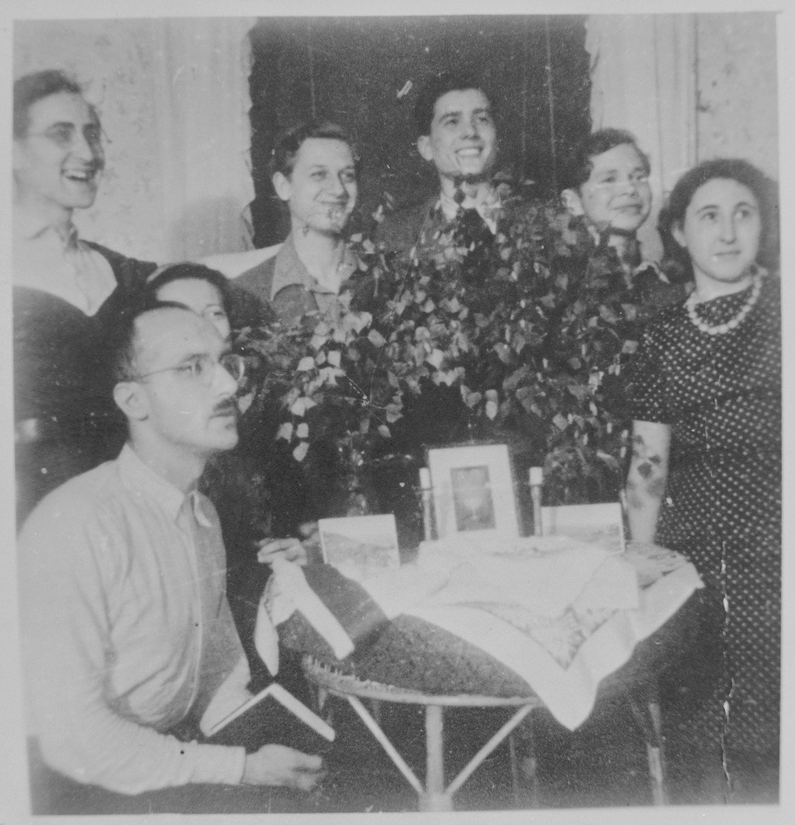 Members of the Chug Halutzi underground Zionist youth group celebrate Shavuot at the home of Gad and Miriam Beck.   Pictured from left to right are: Gad Beck, Yizchak Schwersenz, Edith (Ewo) Wolff (hidden), Zwi Abrahamssohn, Poldi Chones, David Billard, and Miriam Beck.