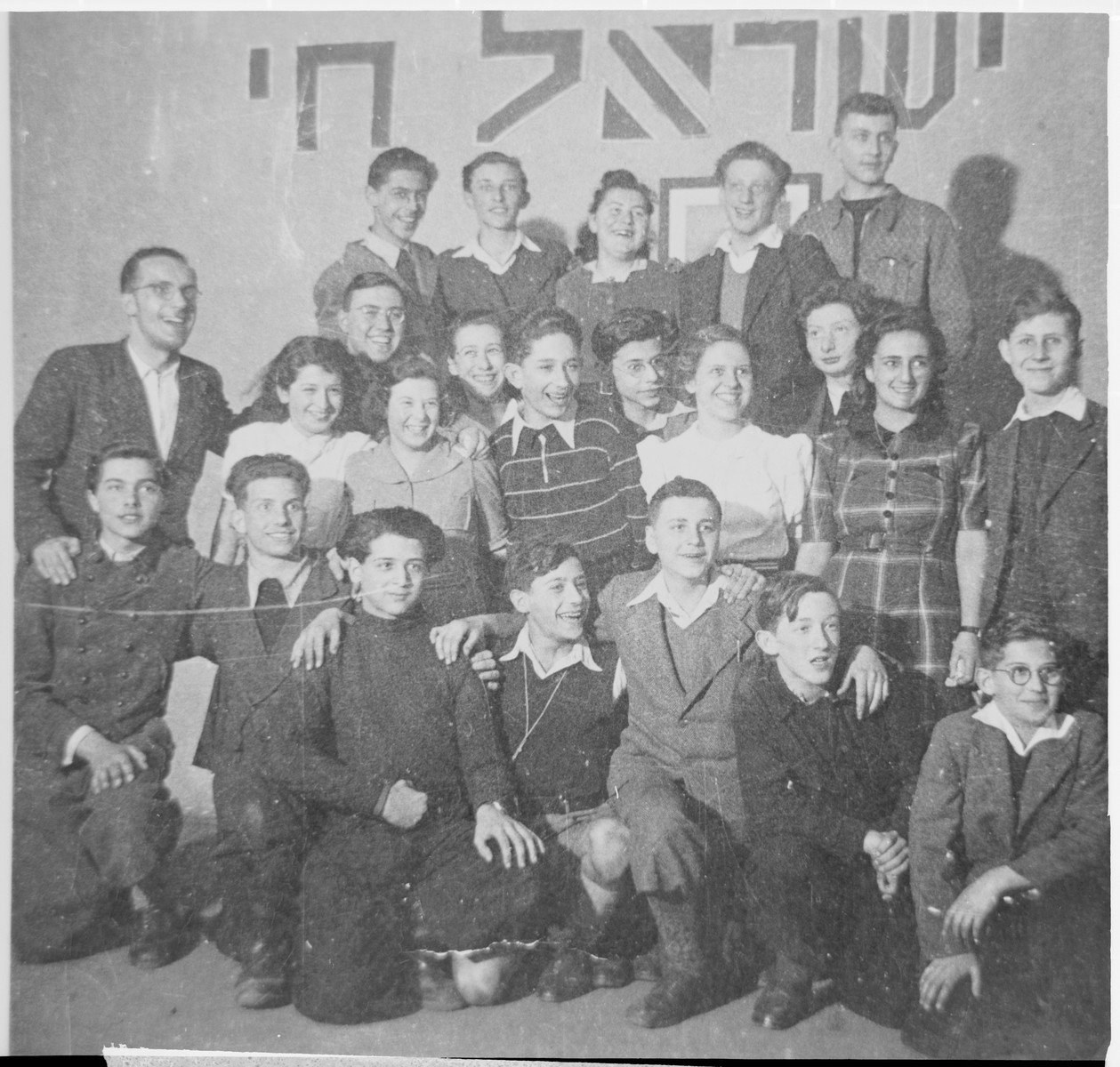 Group portrait of students and teachers at the Youth Aliyah school in Berlin.  Among those pictured is the director of the school, Jizchak Schwersenz (standing at the left).