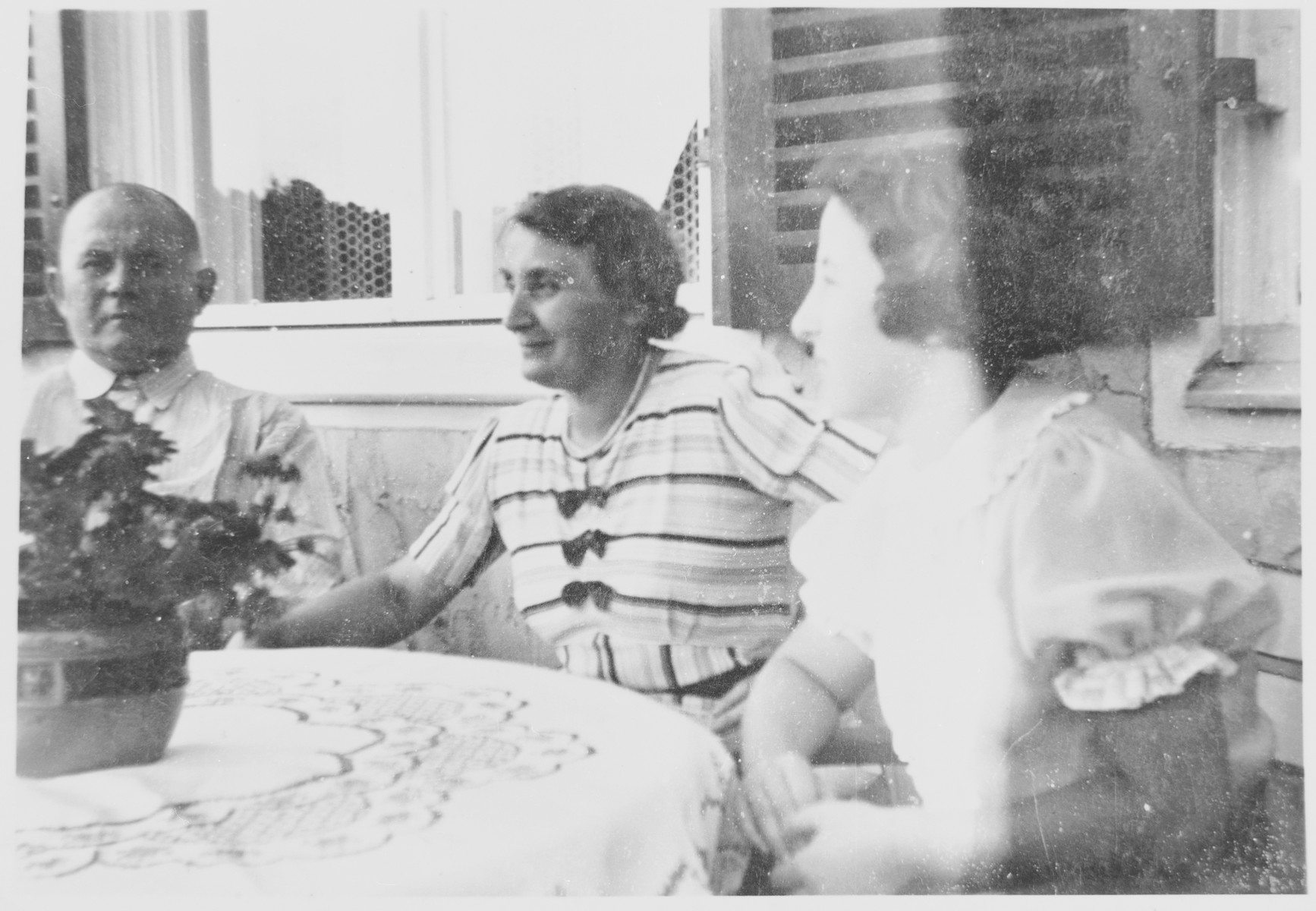 A Jewish Mischling girl living illegally with Christian relatives in Teltow, Germany.    Pictured from right to left are: Margot (Miriam) Beck, her maternal aunt, Martha, and her uncle Alfred (Wobbi) Ludwig.