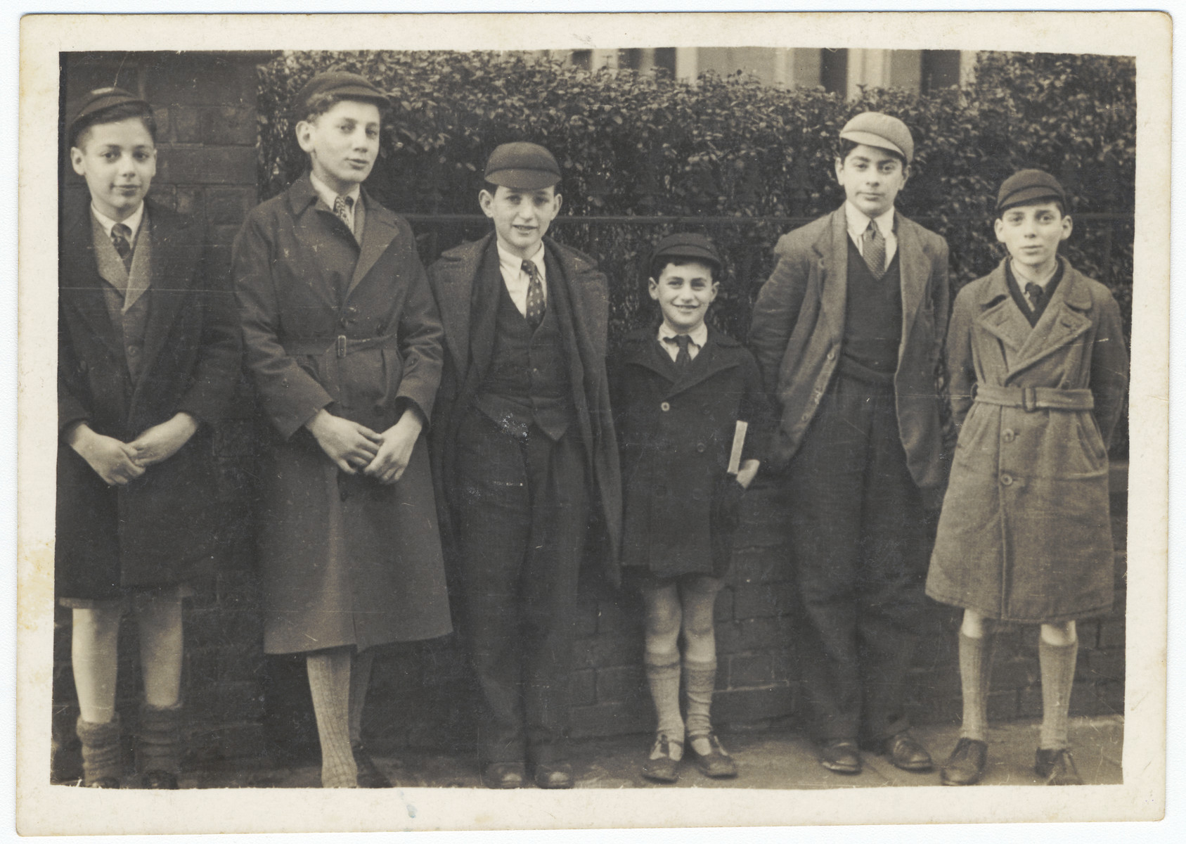 Six Jewish boys who came to England on a Kindertransport pose outside the synagogue in Nottingham.  From left to right are Martin Eiseman, Joseph Haberer, Lutz Goldner, Benjamin Bamberger, Henry Duckstein and Werner Cohn.