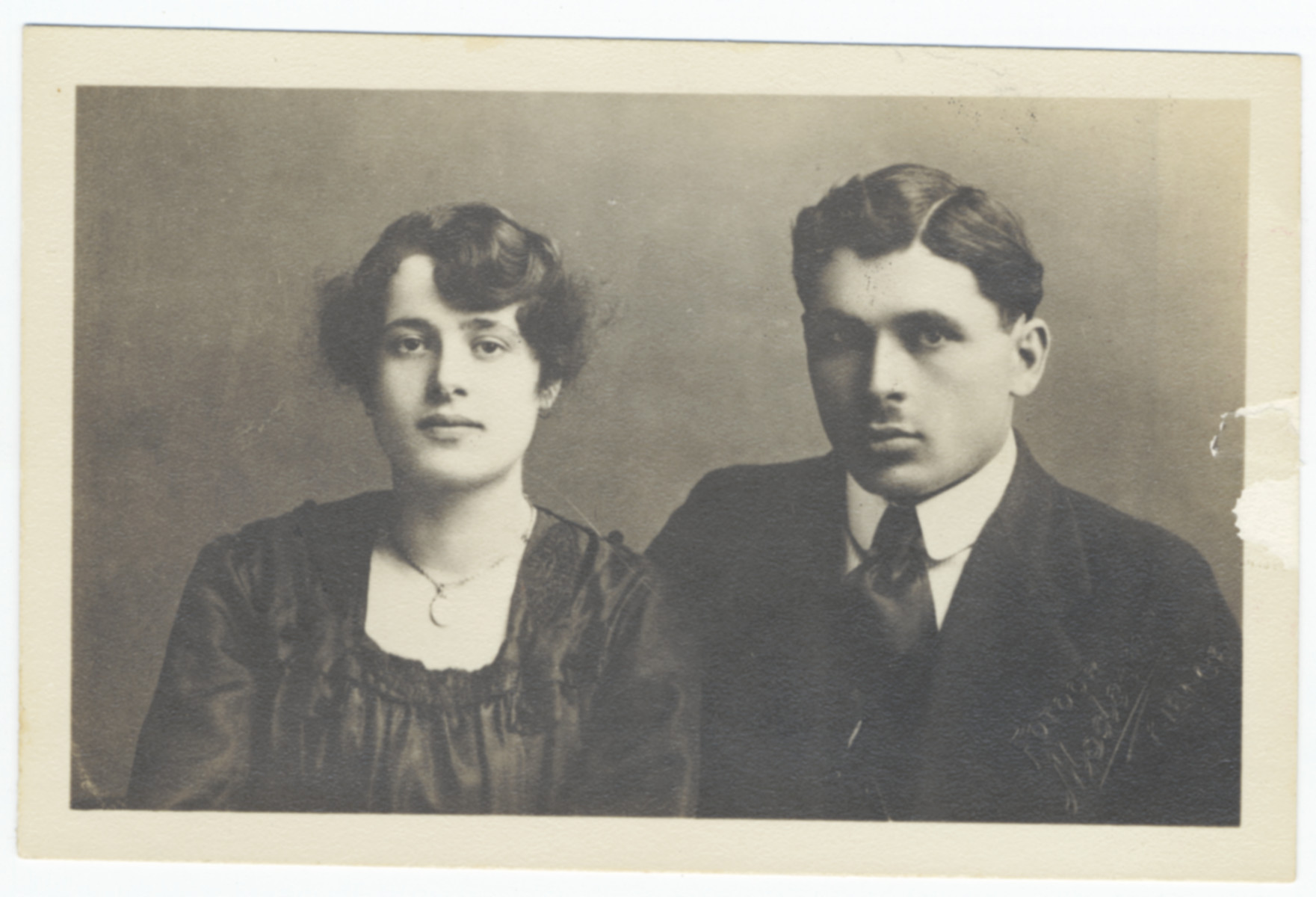 Studio portrait of a Jewish couple in prewar Poland.  Pictured Malka and Gedaliah Moszkowicz.