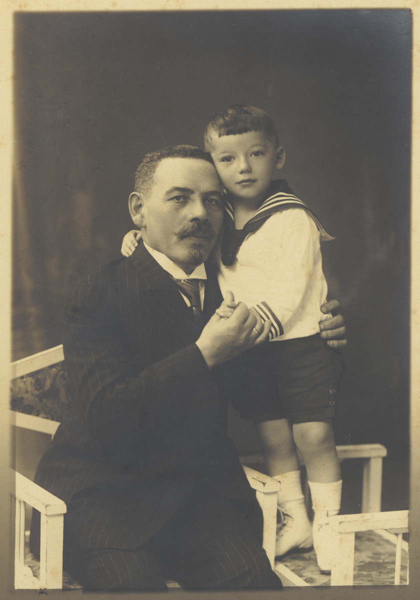 Close-up portrait of a Jewish grandfather and his young grandson in Kaunas, Lithuania.  Pictured are Shlomo Buchkanz and Alexander Zeidel.