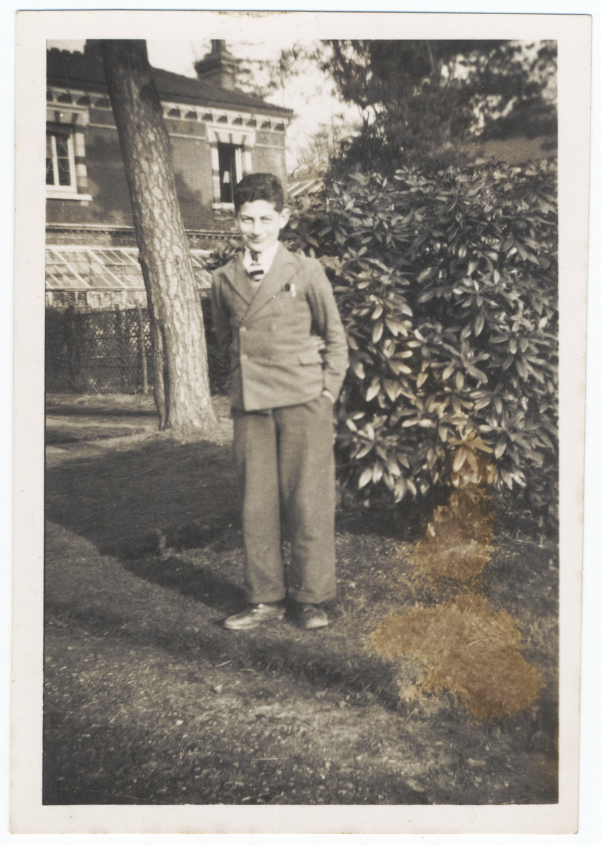 Theo Markus Verderber poses on the grounds of the Sherrads boys' hostel after arriving in England on a Kindertransport from Zbaszyn, Poland.