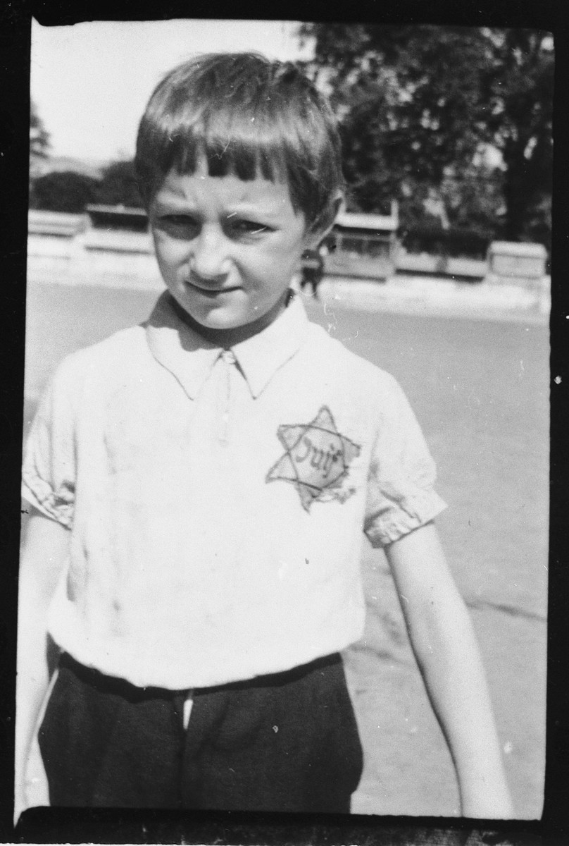 Portrait of a Jewish child wearing a Star of David.
