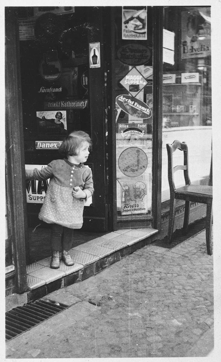 Hannelore Mansbacher  in front of the grocery store of her parents.