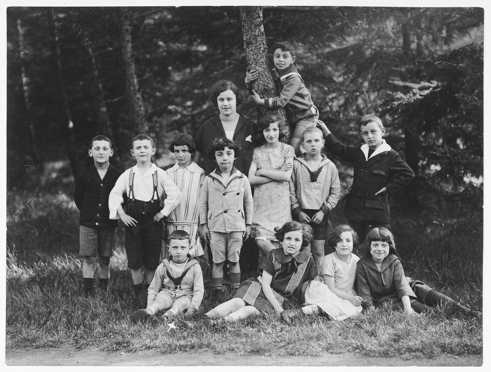 Children from a religious school in Bremen enjoy an outing in the woods.  Gerd Zwienicki is seated in the bottom left.