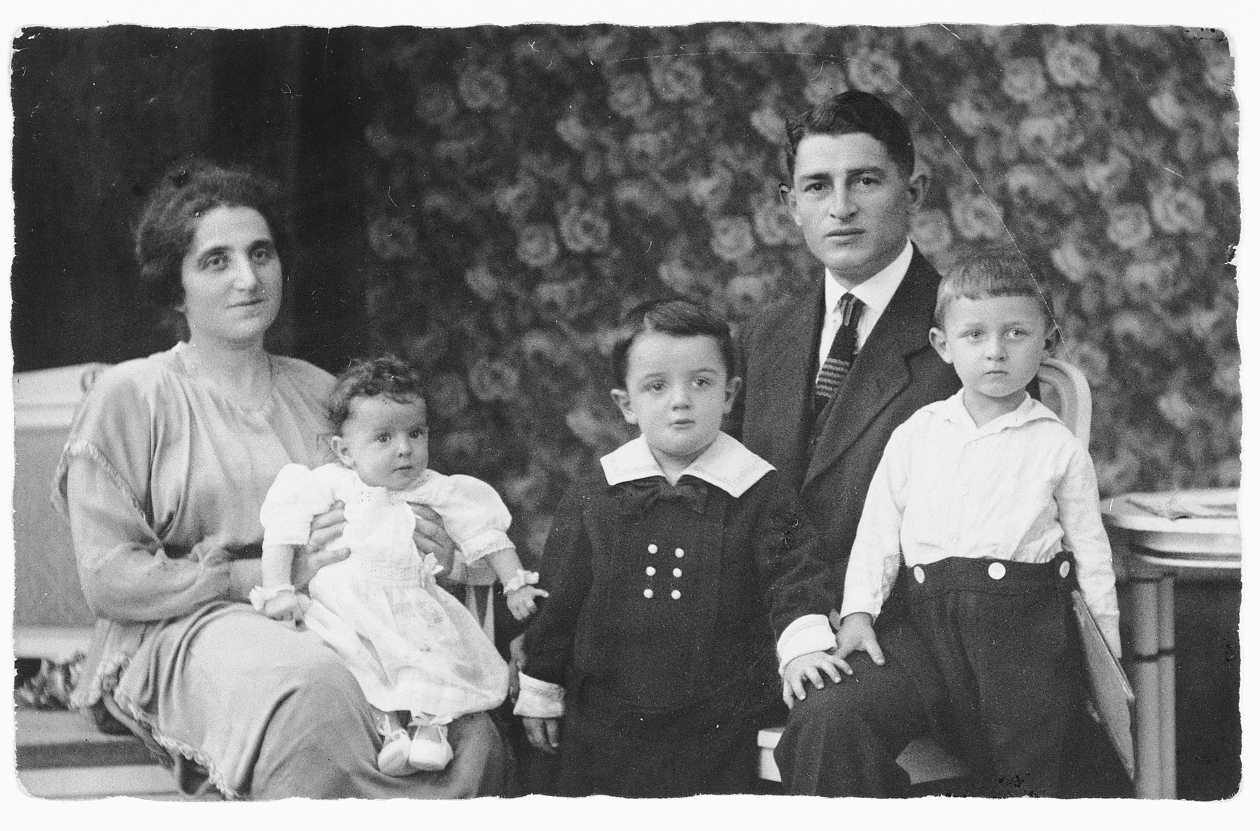Studio portrait of a prewar German-Jewish family in Bremen.  From left to right are Selma Zwienicki holding her daughter Liesel, Benno, Josef Zwienicki and Gerd.