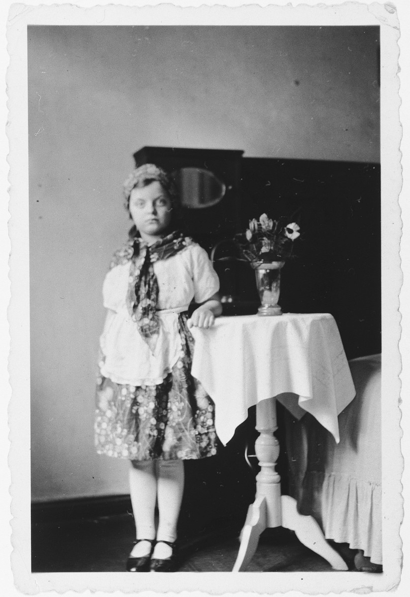 Hannelore Mansbacher poses in her home in a Purim peasant costume.