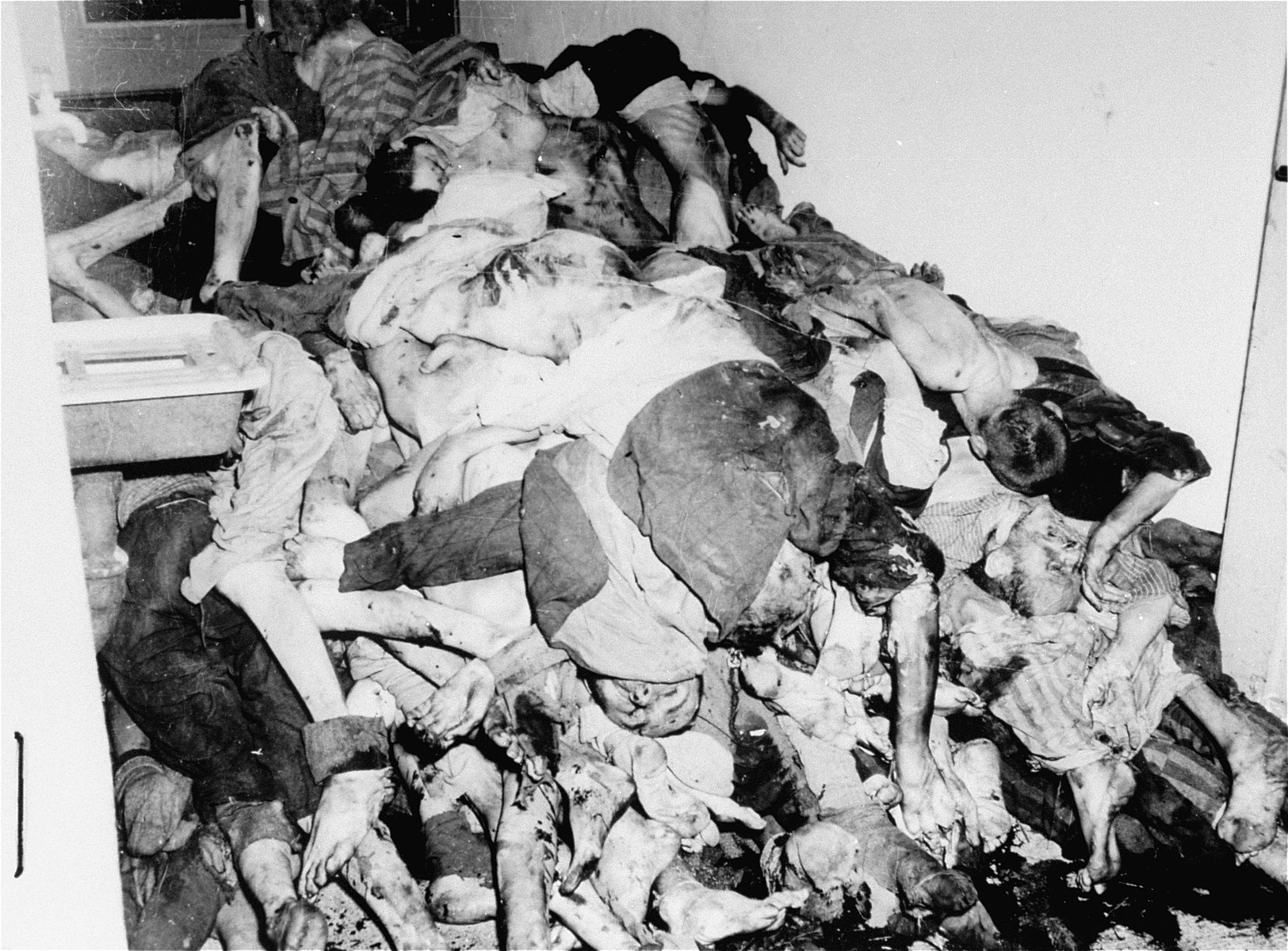 Corpses piled in the crematorium mortuary.  These rooms became so filled with bodies that the SS staff and survivors began to pile corpses behind the crematorium, where they were found by U.S. troops during the liberation of the camp.