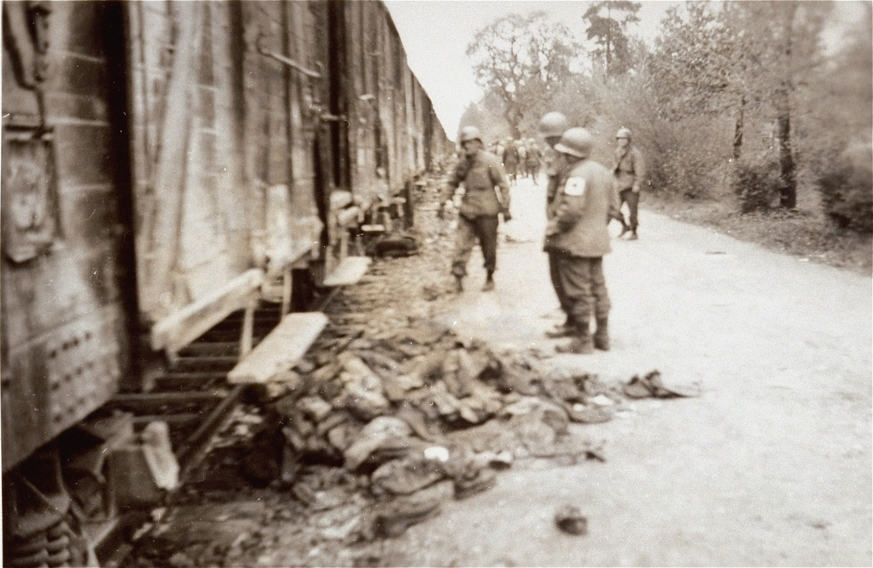 American soldiers view the Dachau death train.  The soldier on the left is Lt. Robert P. Teten.