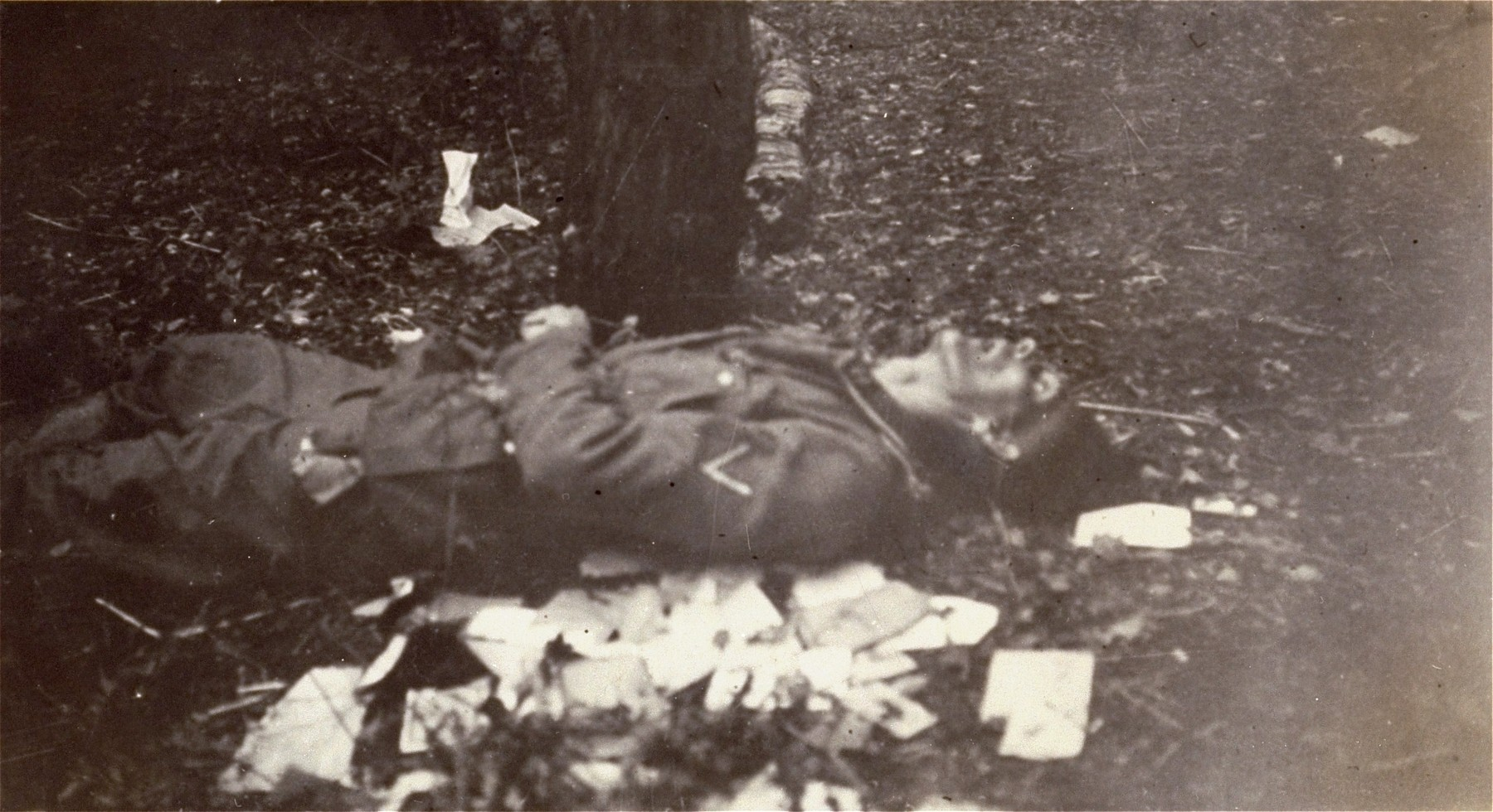 The body of an SS guard in the newly liberated Dachau concentration camp.