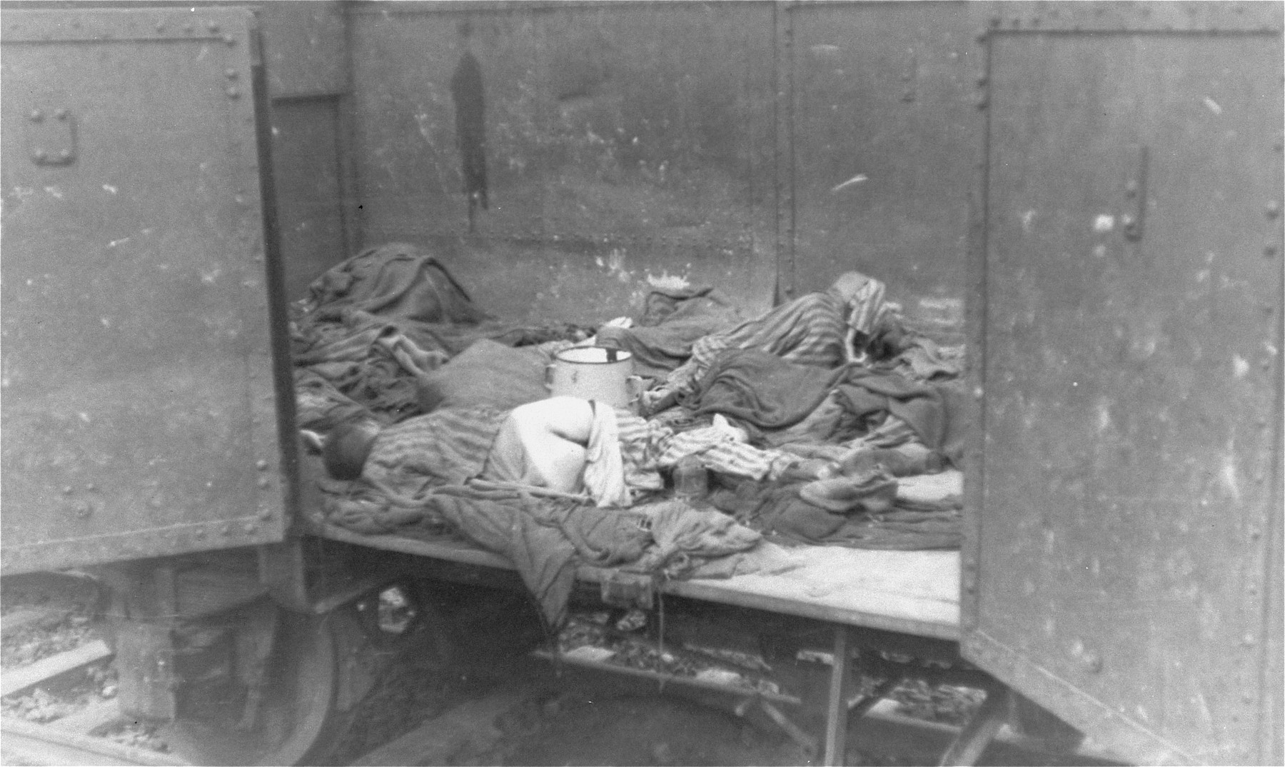 Corpses lie in one of the open railcars of the Dachau death train.