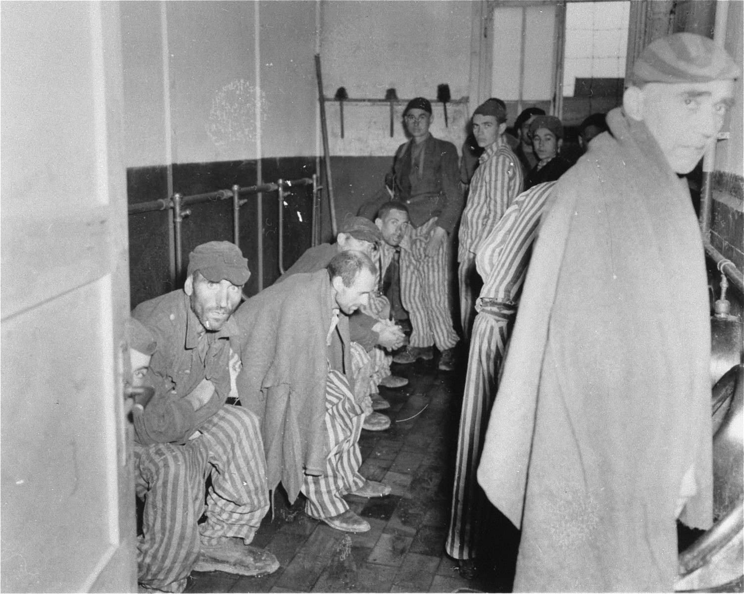 Survivors in the latrine barracks after liberation.