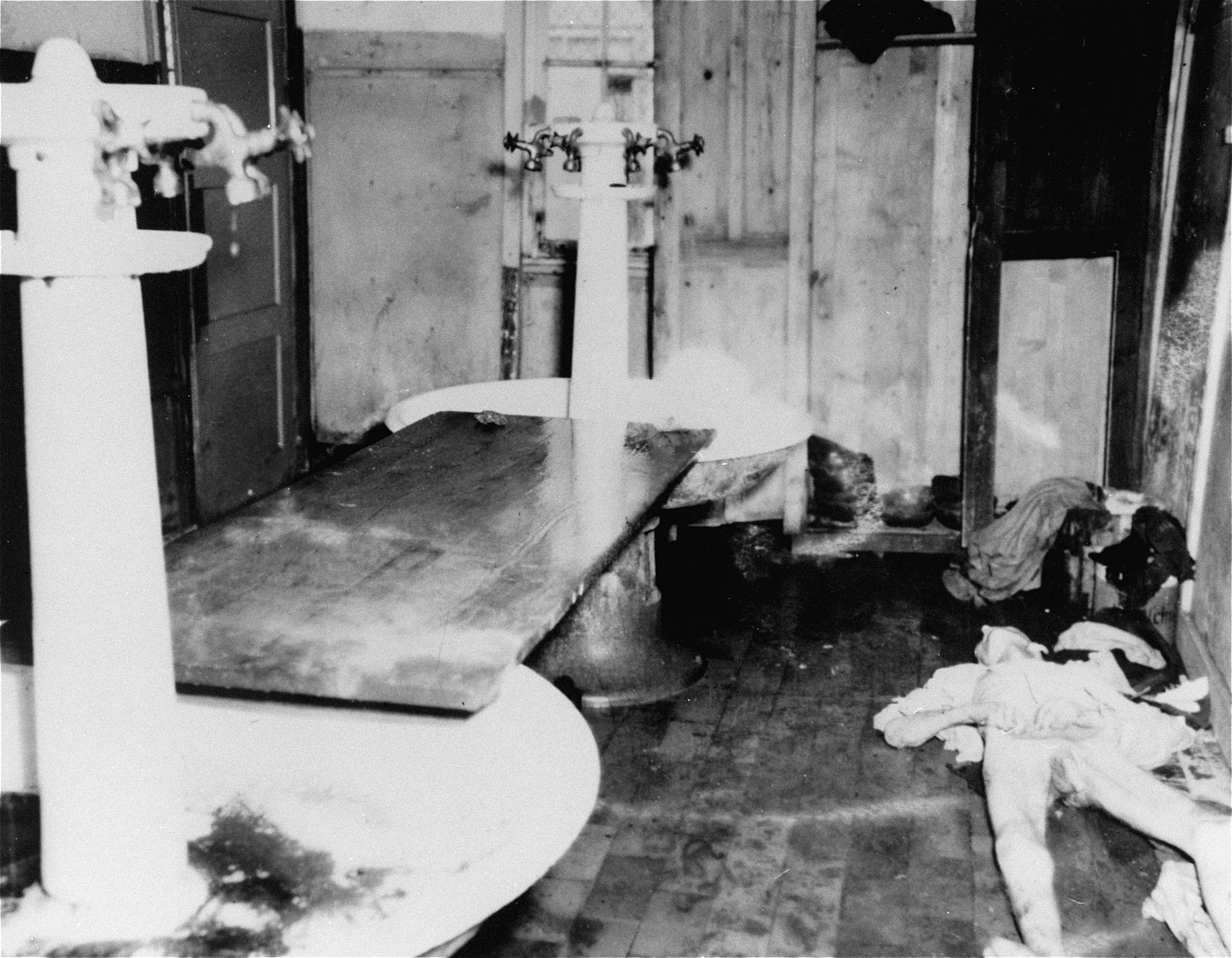 A corpse in the washroom after liberation.