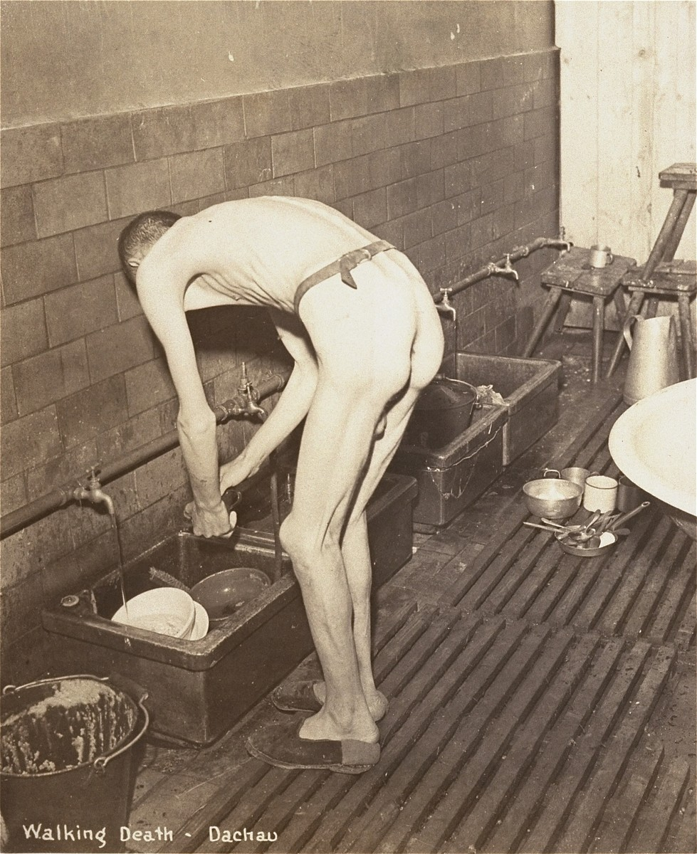 A survivor washes dishes.
