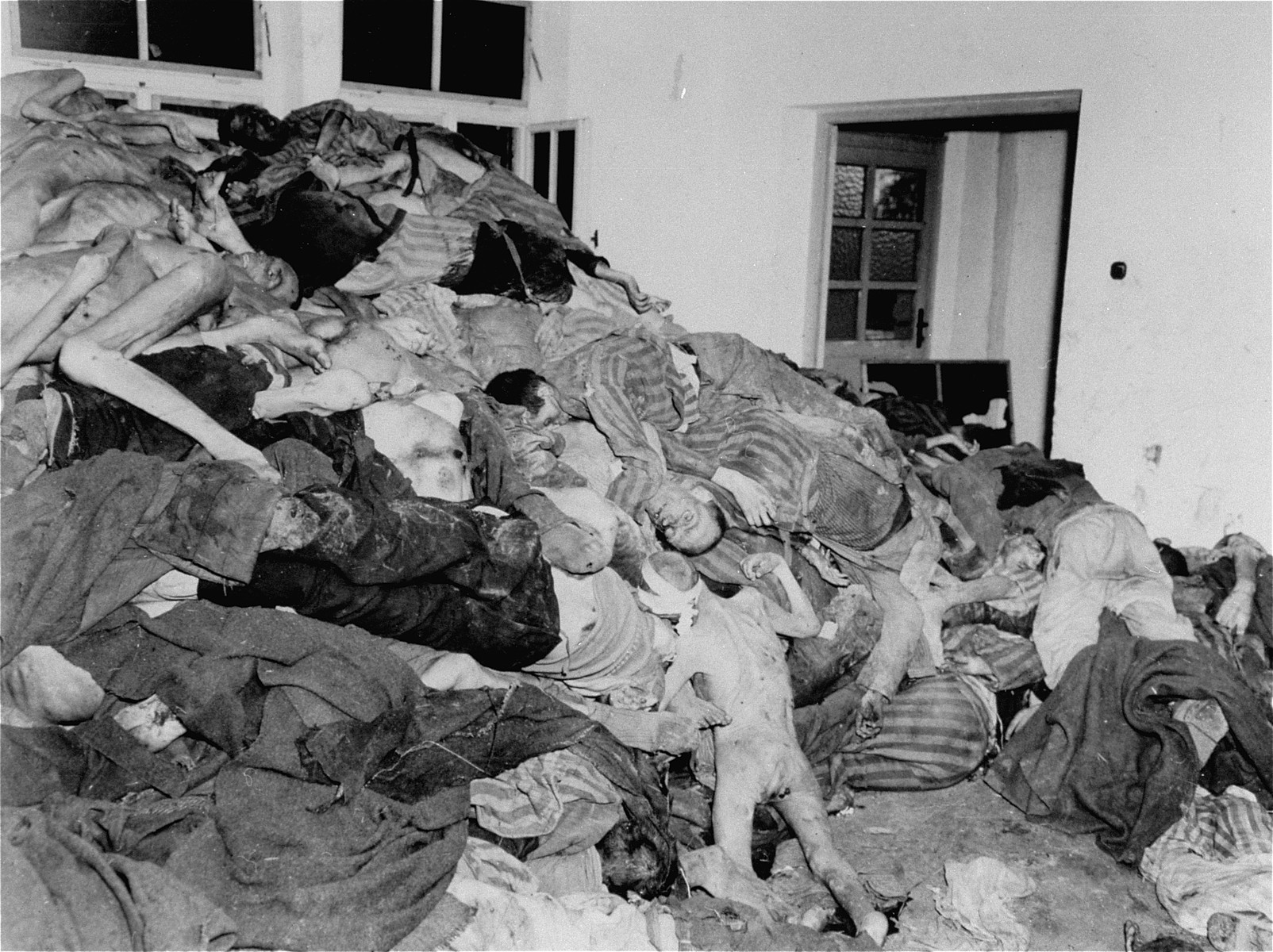 Corpses piled in the crematorium mortuary.  These rooms became so full of bodies that the SS staff and survivors began piling them behind the crematorium, where they were found by U.S. troops during the liberation of the camp.