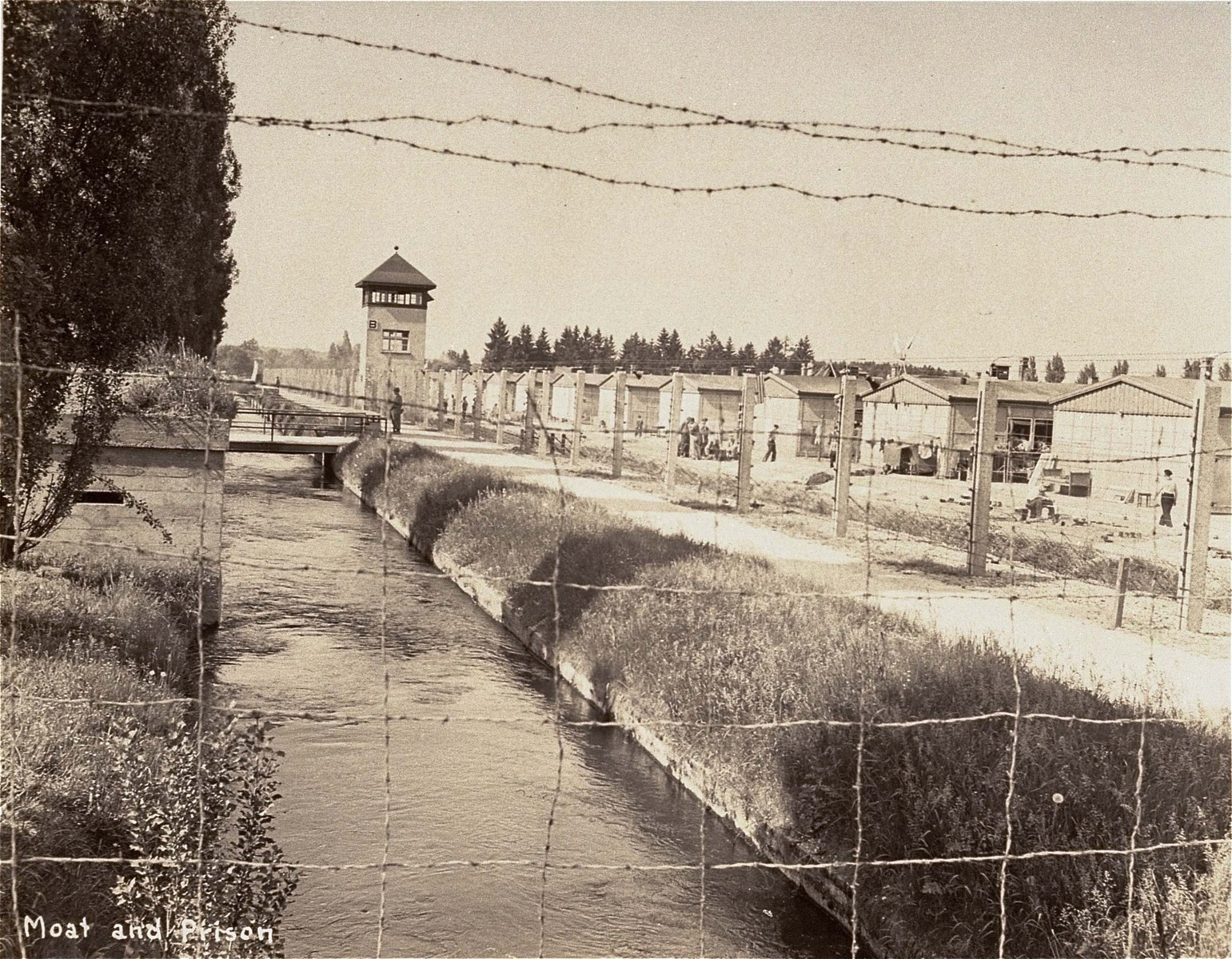 View of a section of the newly liberated Dachau concentration camp as seen through the barbed wire fence.