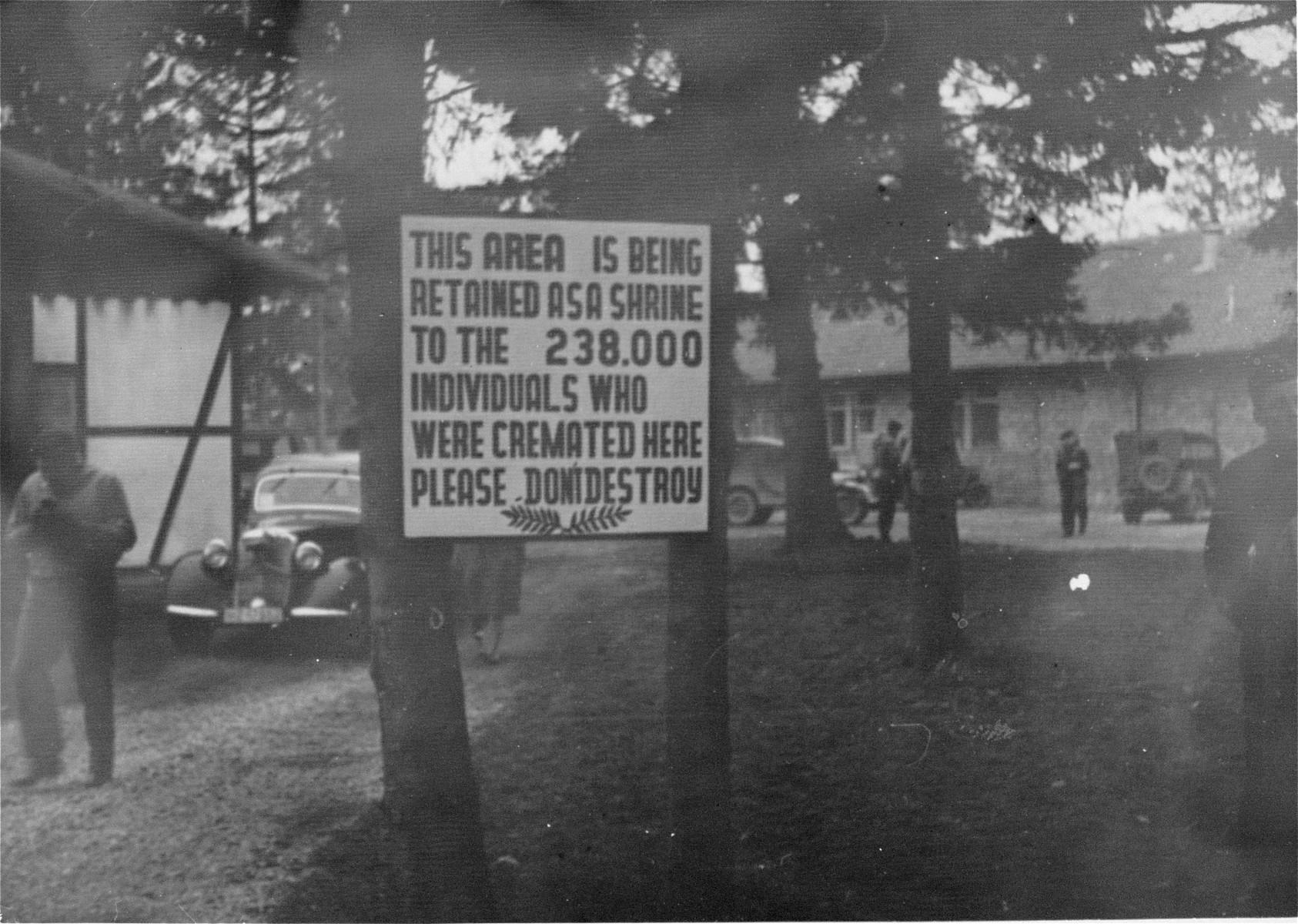 A memorial sign in front of the crematorium in Dachau.