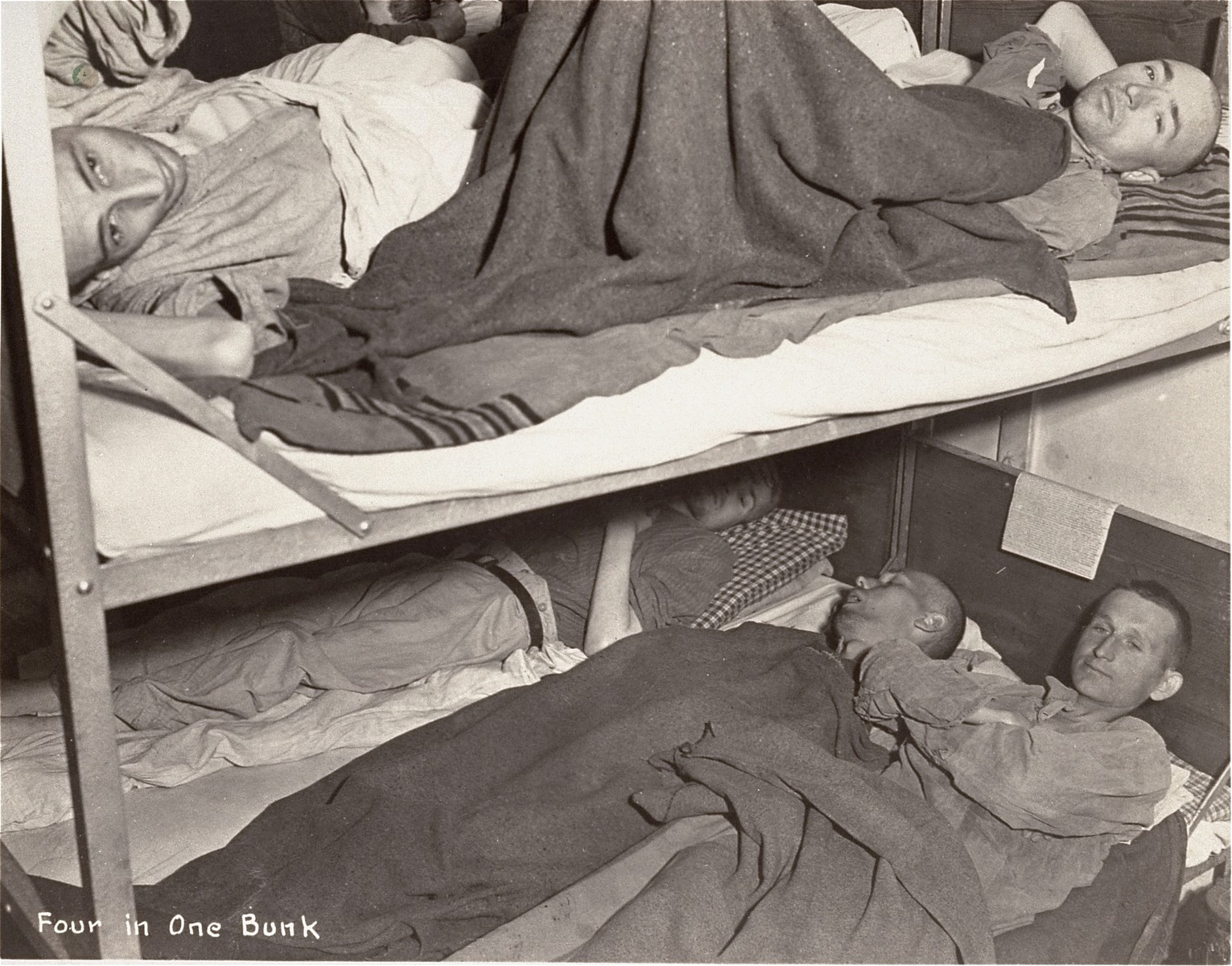 Survivors in a hospital ward after liberation.