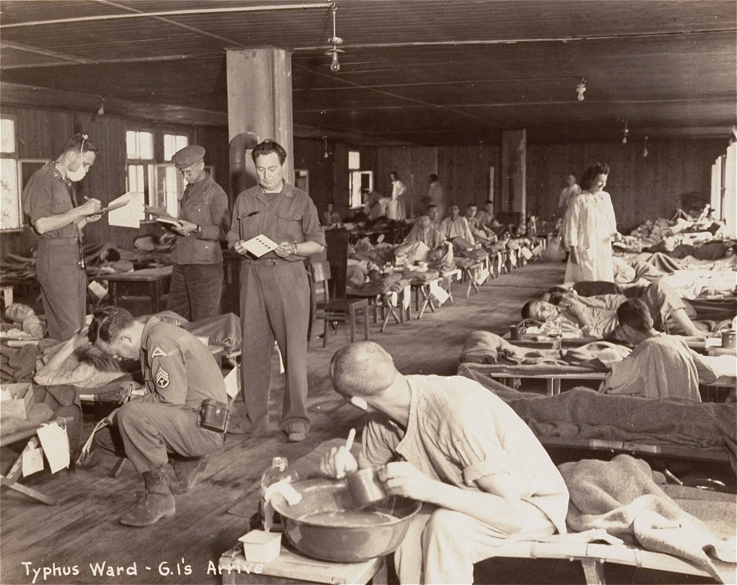 American medical personnel at work in a typhus ward in a hospital for Dachau survivors.