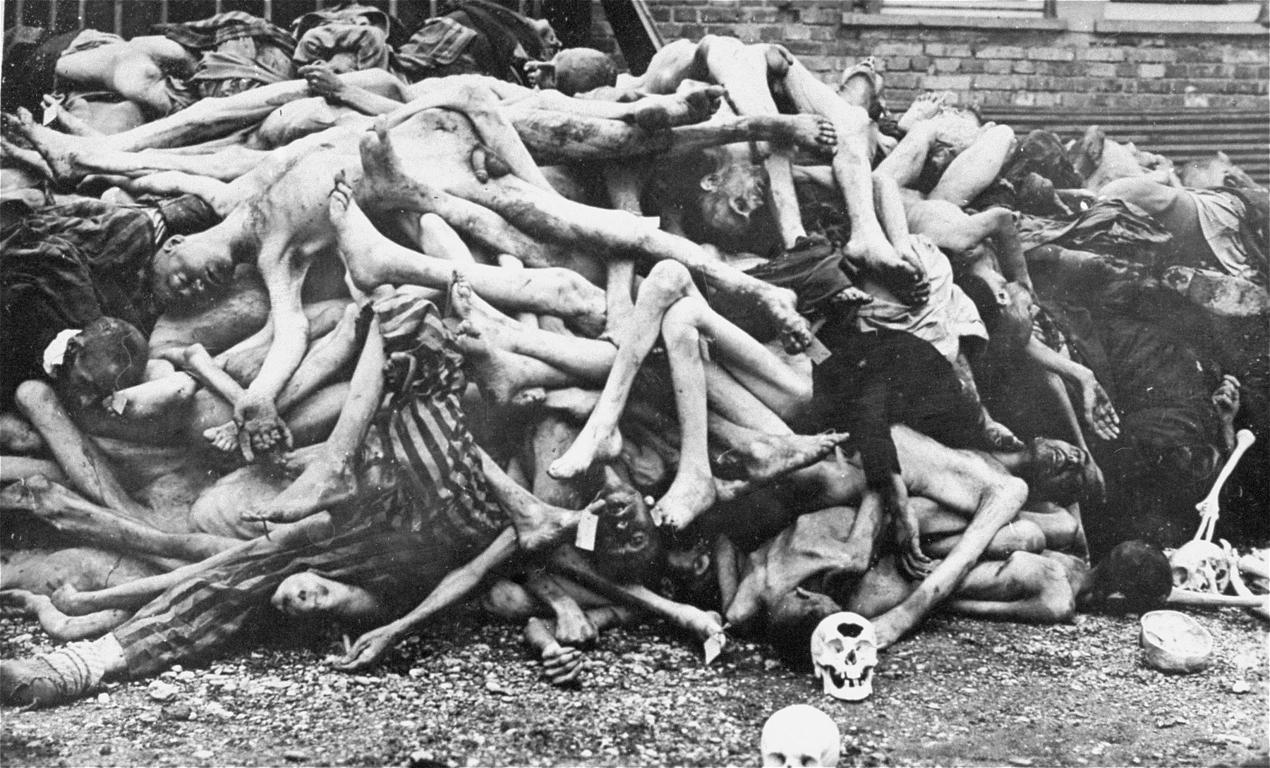 The bodies of former prisoners are piled outside the crematorium at the newly liberated Dachau concentration camp.