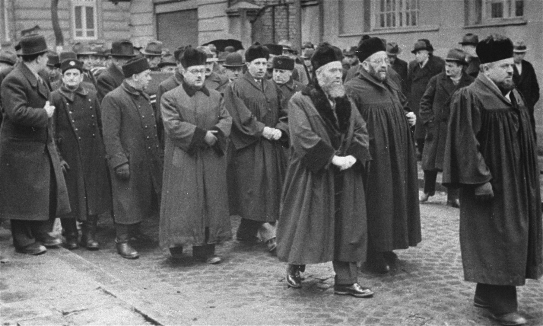 Dr. Asher Hananel, Chief Rabbi of Sofia (at the right in the foreground), leads a funeral procession for Nissim Yasharoff (the donor's grandfather) through the streets of Sofia.    The funeral took place a few days after the arrival of German troops in Bulgaria.  Also pictured is Rabbi Daniel Zion, Chief Rabbi of Bulgaria.