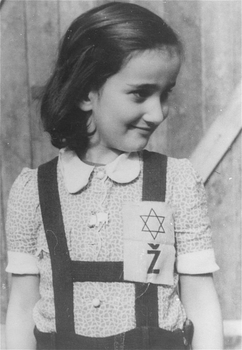 Portrait of a young girl in the Loborgrod concentration camp wearing a Jewish badge.  According to recent research this photograph was taken in Auschwitz.