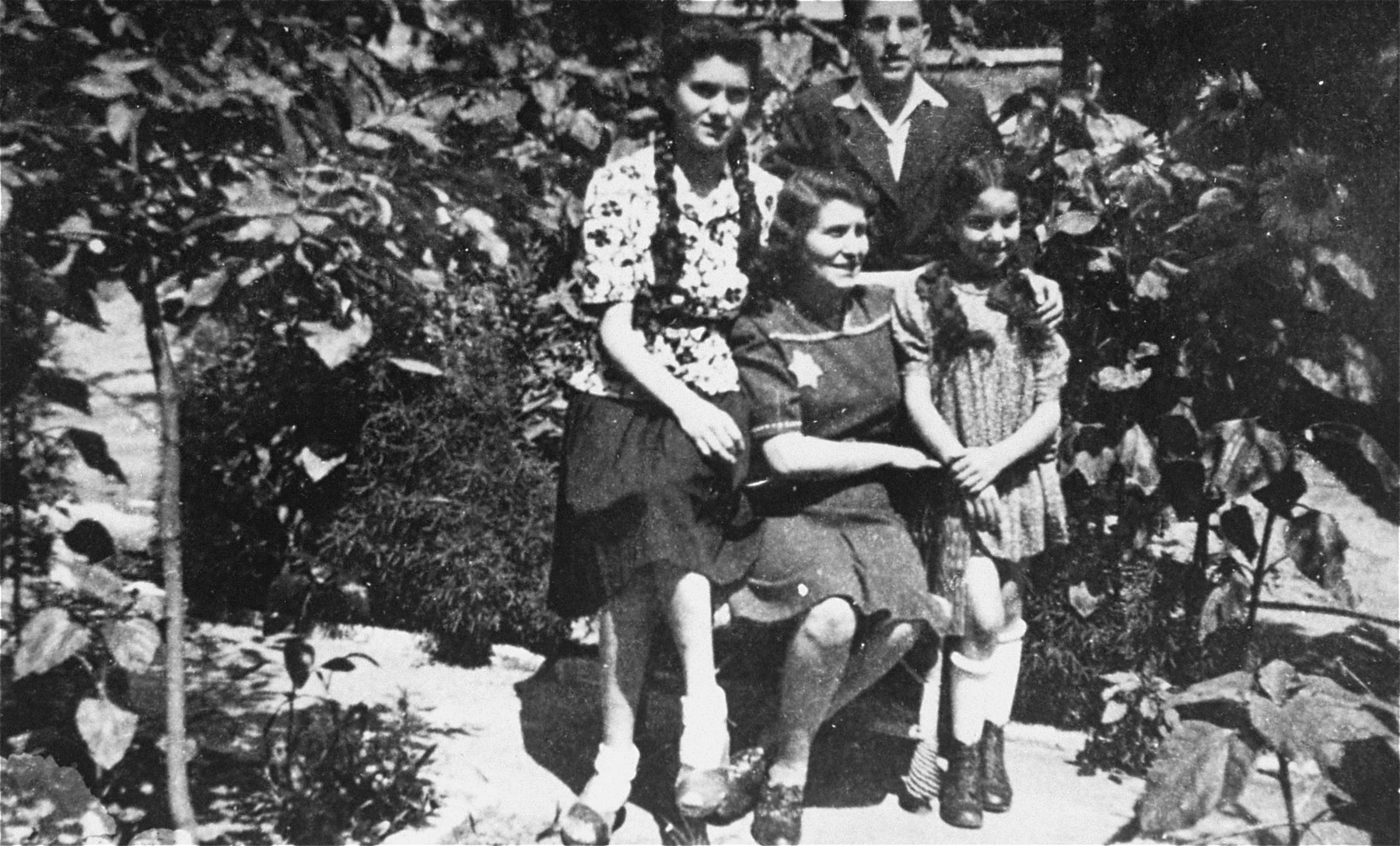 Portrait of the Aigner family in Nove Zamky.  Pictured are Laszlo (Leslie), his sisters Elisabet and Marika, and their mother Anna.