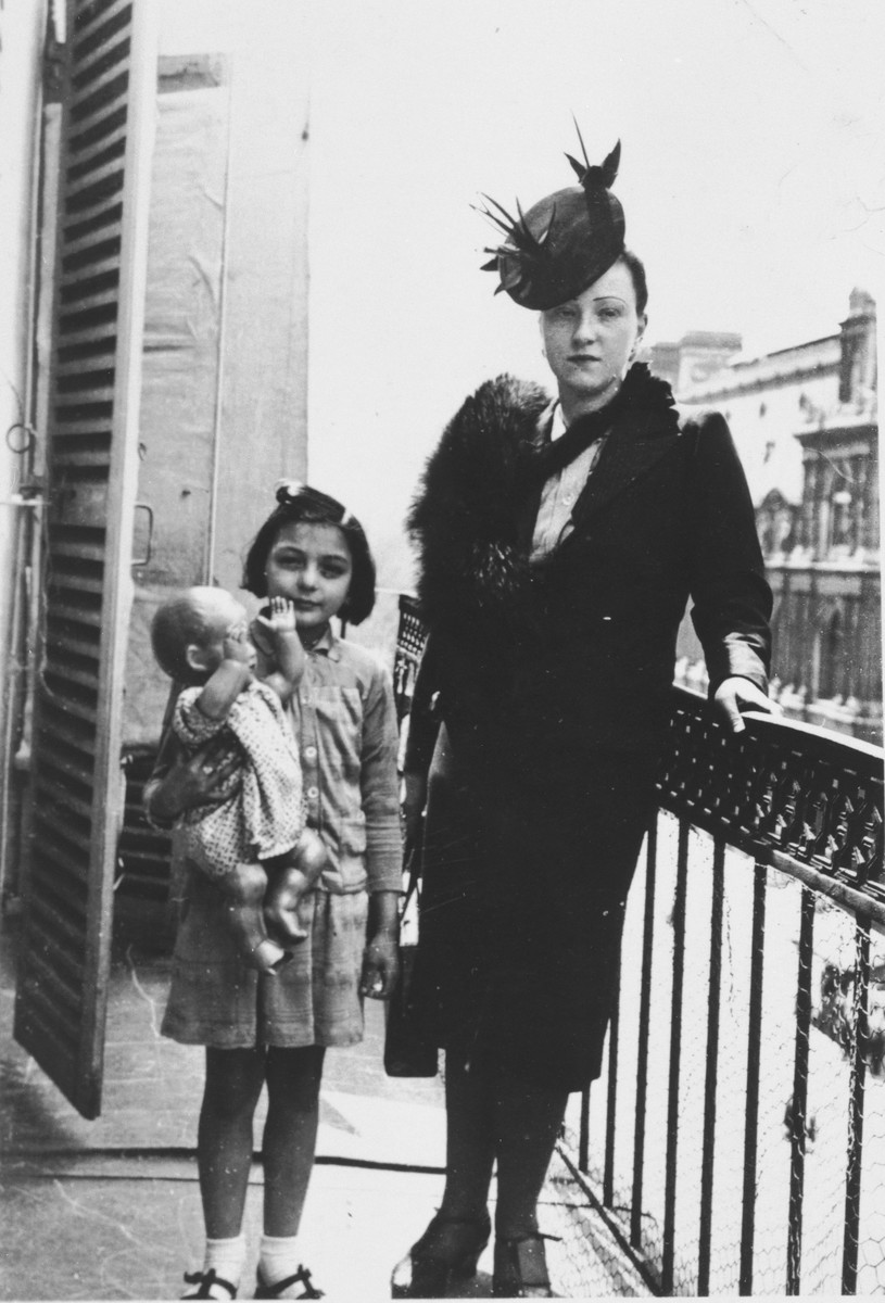 Brenda Hershkovitz poses with her doll and her mother, Rosette, on the balcony of the family's apartment, shortly before the start of World War II.