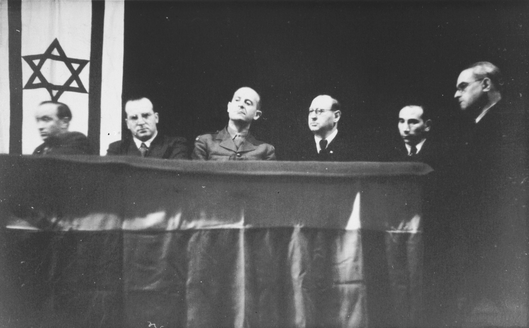 Meeting of the leadership of Jewish displaced persons in the British zone.  Those pictured include Mr. Yunis, Abraham Lipshitz, Norbert Wollheim, and Josef Rosensaft.