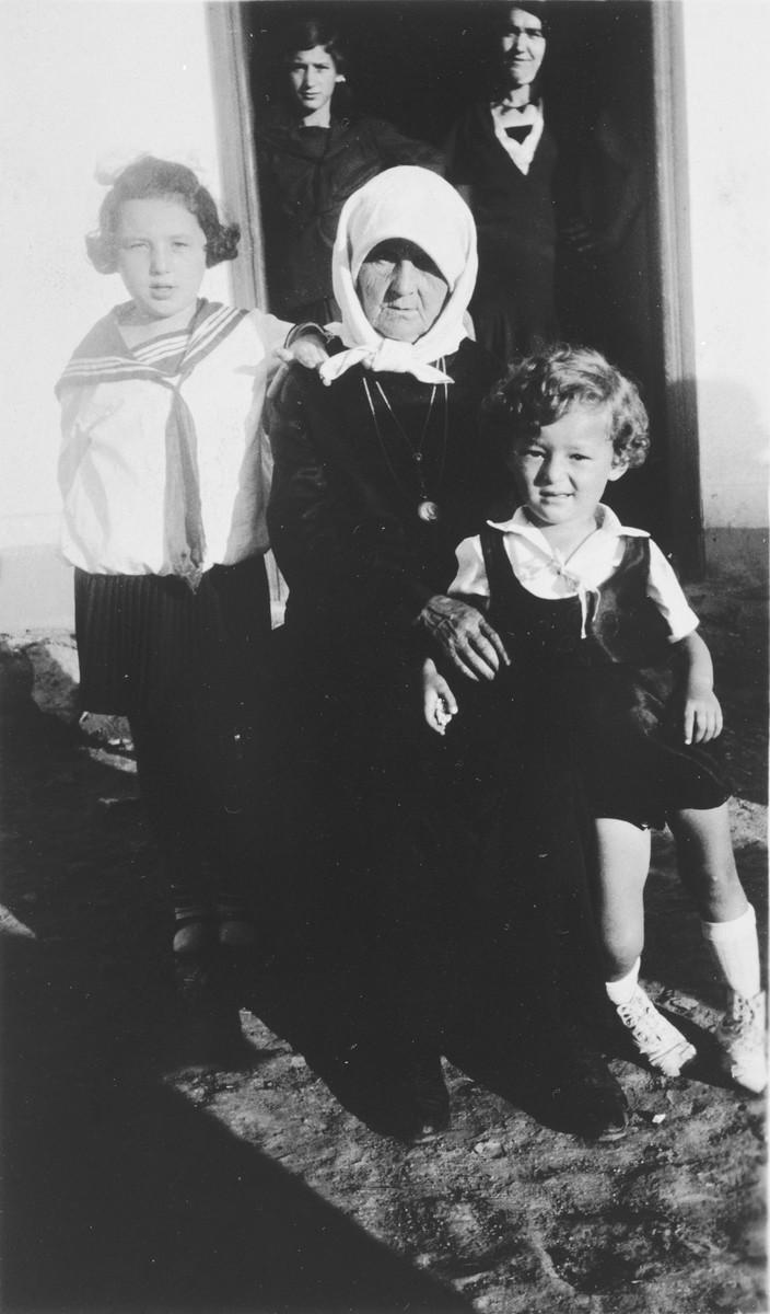 Yetta Baila Gutstein poses with her grandchildren Effcha and Asche in the small shtetl, Ustye Zelenoye.
