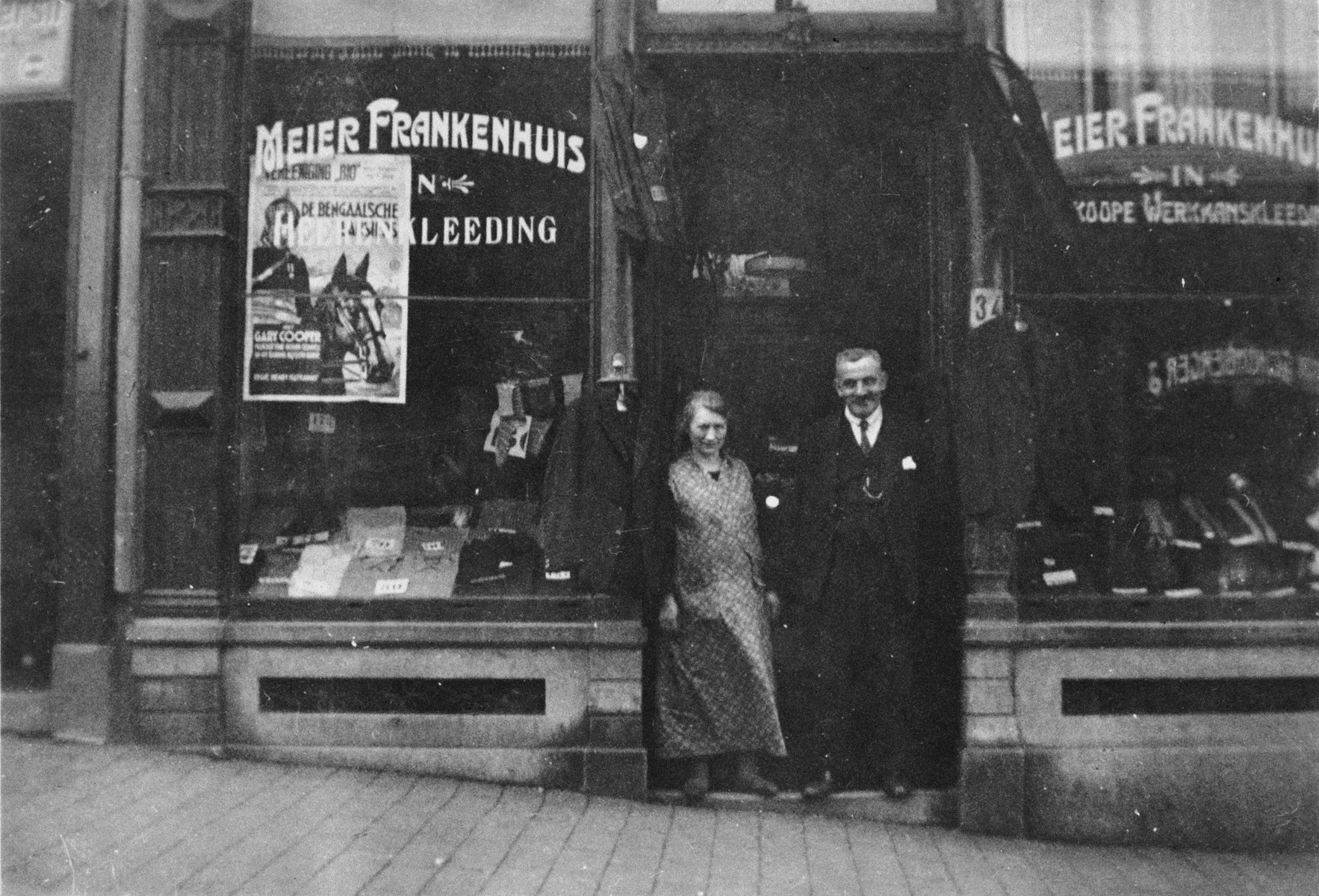 Meir and Wilhelmina Fankenhuis pose outside their clothing shop in Nijmegen, The Netherlands.