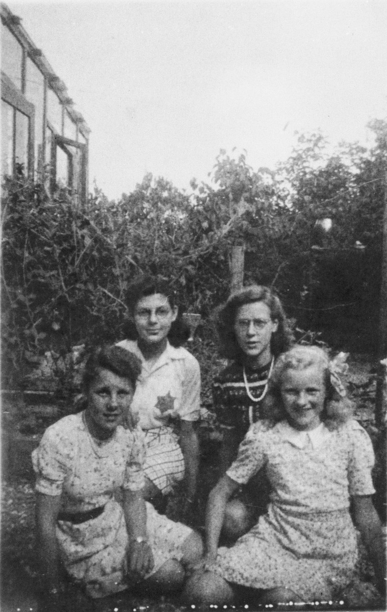 Judith Wilhelmina de Leeuw, wearing a Jewish star, poses with three Christian friends.