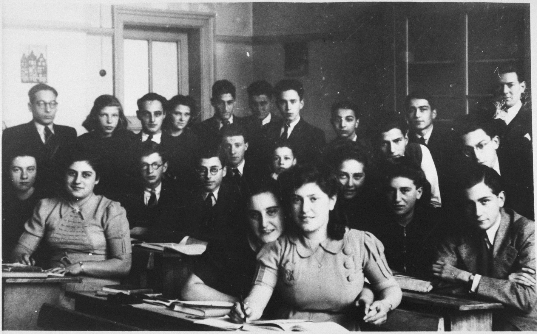 Class portrait of the Jewish high school in Amsterdam.  Bloeme Emden is pictured in the front , right.