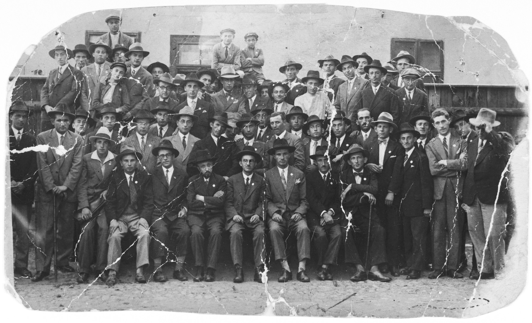 Group portrait of the members of the Mizrahi Zionist movement in Sighet.  Among those pictured are the leader, Mr. Koffler, head of the Jewish administration in Sighet.  Also pictured are Nachum Feldman, Moshe Yuszt, Efraim Raht, Yossy Yuszt and Ali Israel.