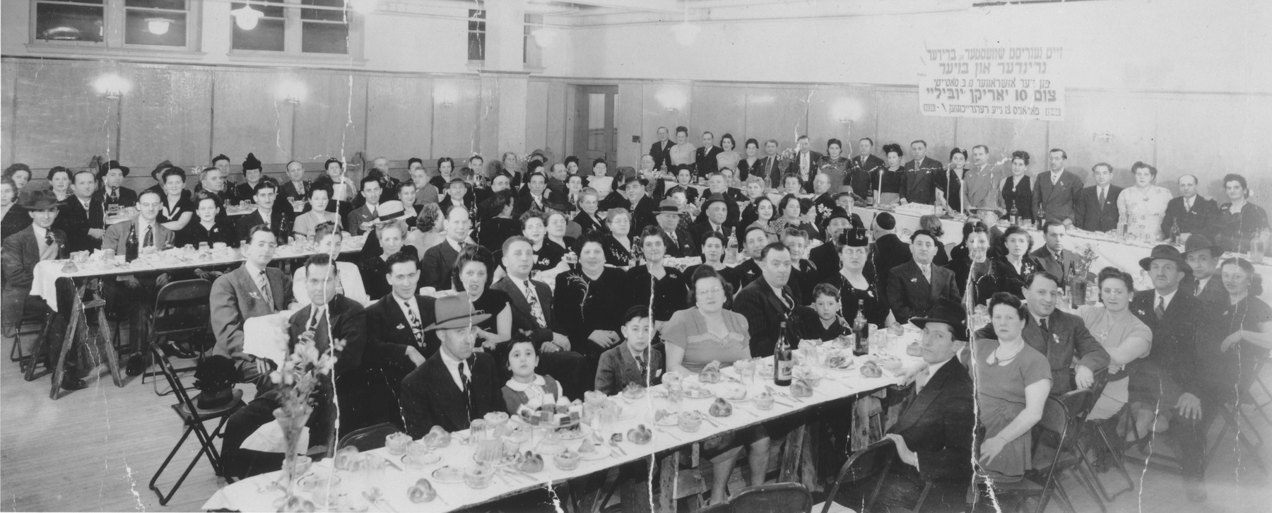 Jewish immigrants to Canada from Ozarow, Poland attend a banquet in Toronto in celebration of the tenth anniversary of the Ozarow society.