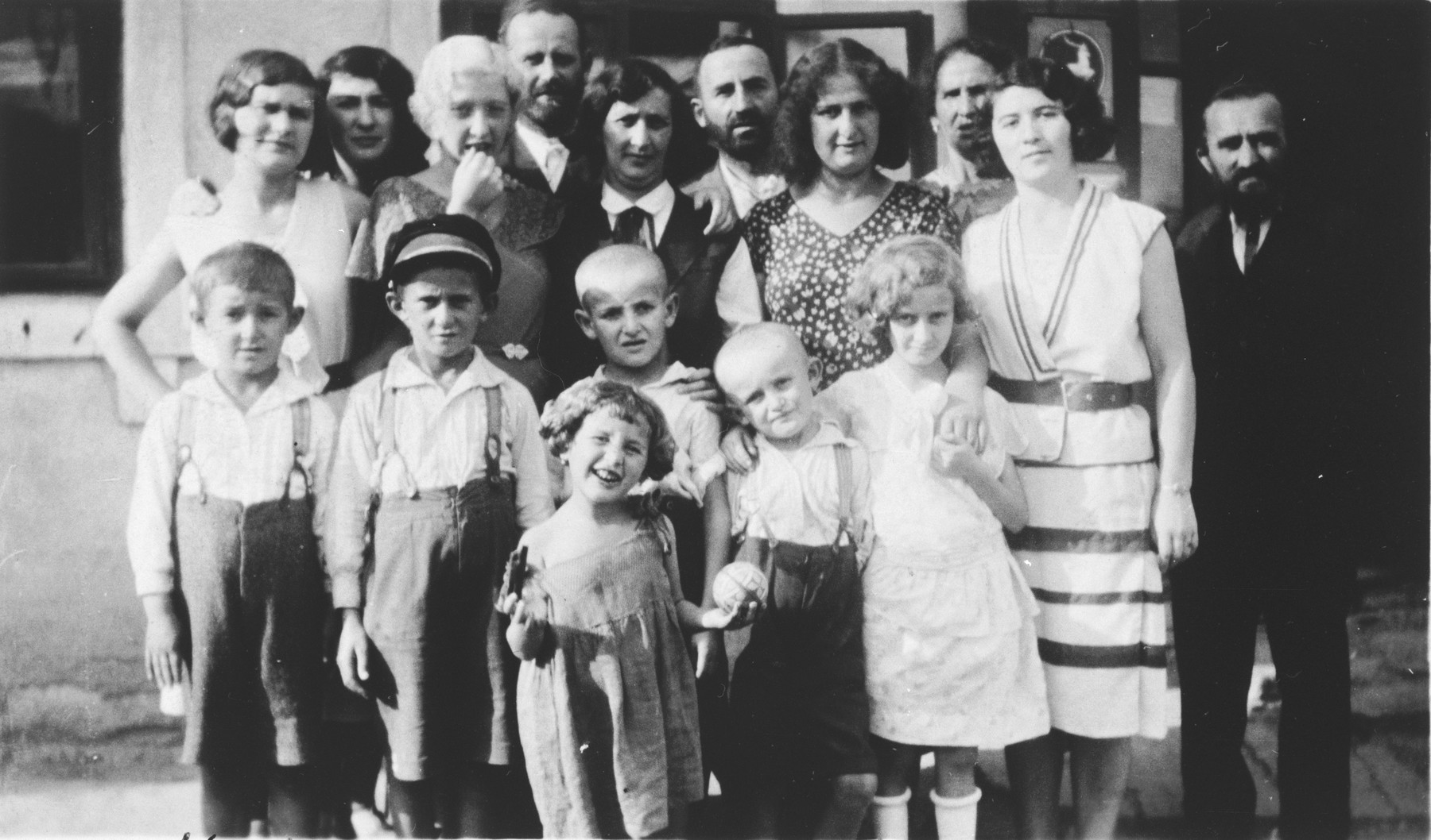 Group portrait of the extended Frisch and Genendlen family taken on the occasion of a visit by cousins in America.