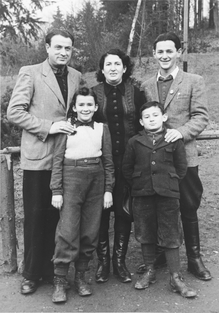 Portrait of the Laufer/David family in the Rochel-Eschenstruth DP camp.  Pictured are Daniel David, Fridjeh Laufer-David, Sylwia and Dawid Laufer and Yehezkel Perl.