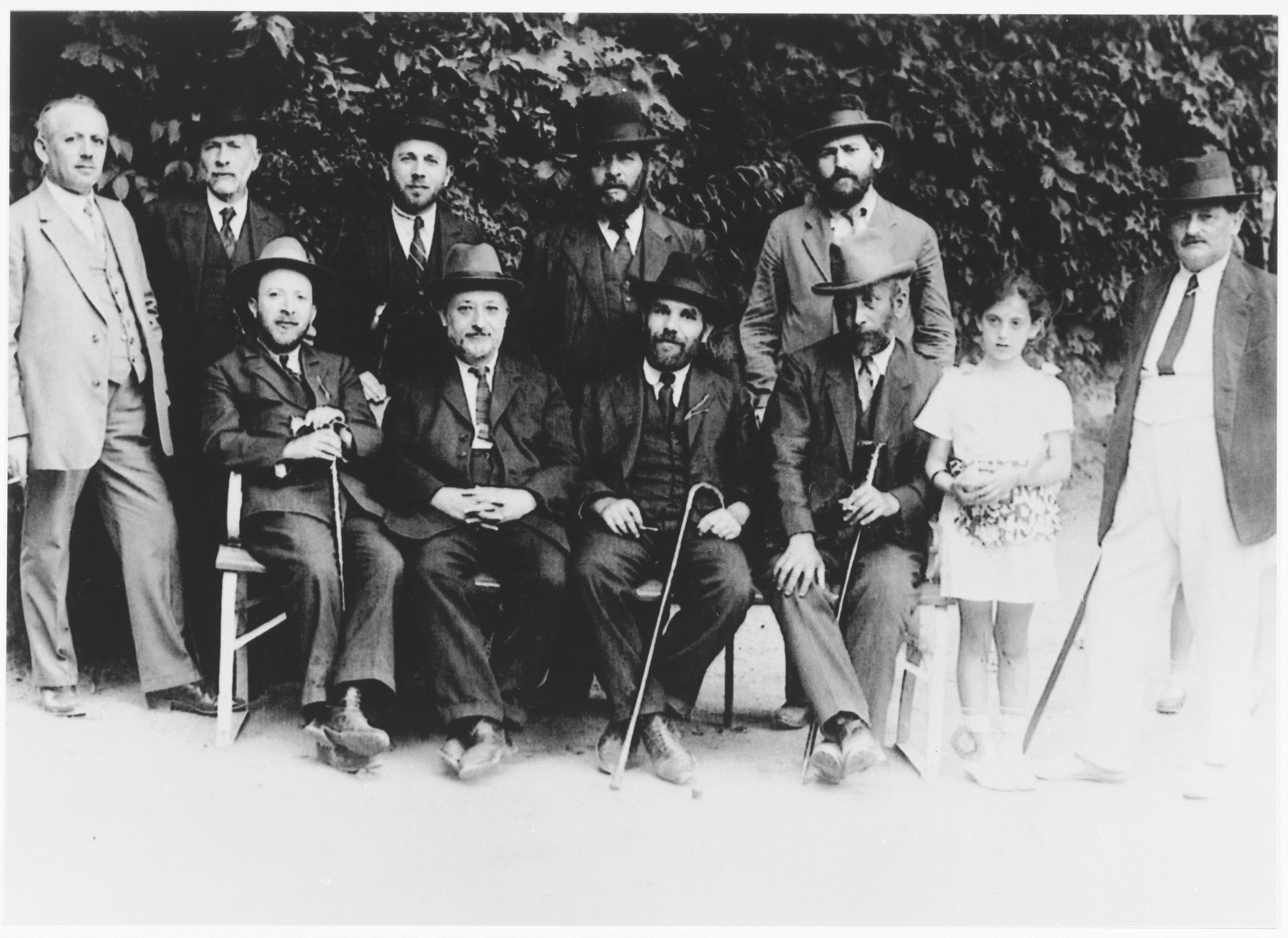 Leaders of the Sighet Jewish community.  Those pictured include Mr. Hershkovich (seated far left), Mr. Klein (seated second from left), Mr. Yacobovich (standing far right) and Mr. Jahan (standing second row, right).