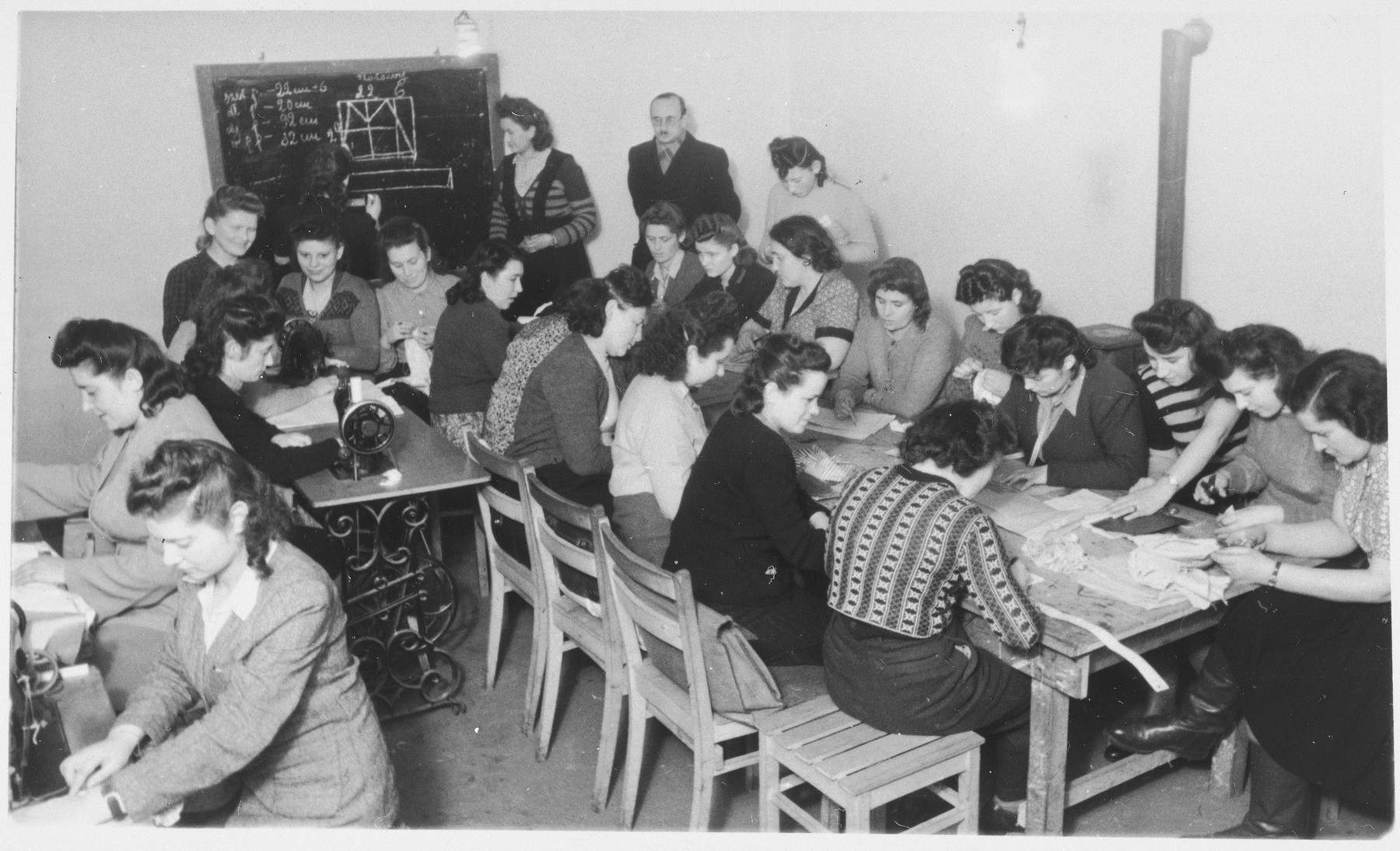 Women study pattern-making in a sewing class in the ORT vocational school at Zeilsheim displaced persons' camp.