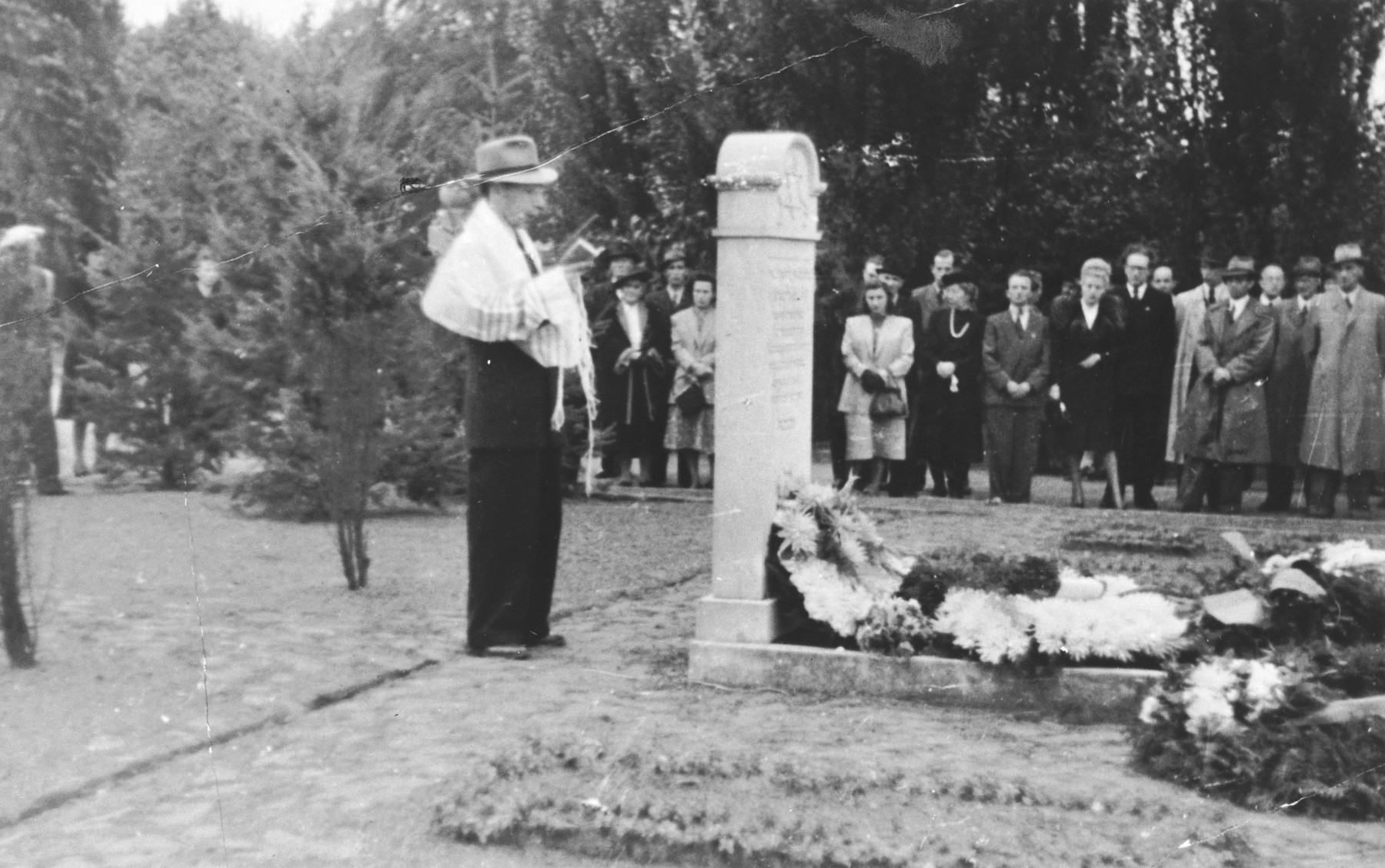 Abraham Lipshitz, leader of Hanover Jewish community, reads memorial prayers following the burial of 367 boxes of ashes of Jews who perished in the Hanover-Ahlem concentration camp.