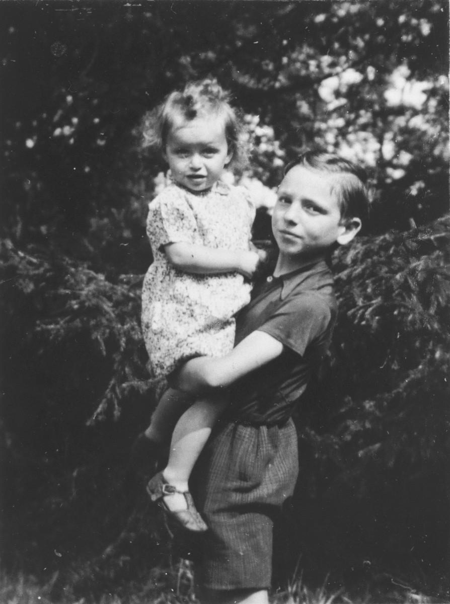 Marguerite-Rose Birnbaum is held by Marcq Dincq, the son of her rescuers, Pierre and Marie-Josephe Dincq.