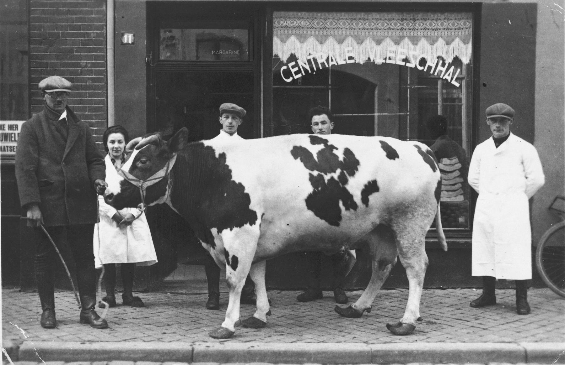 David and Sophia de Leeuw pose outside their butcher shop in Venlo, The Netherlands.