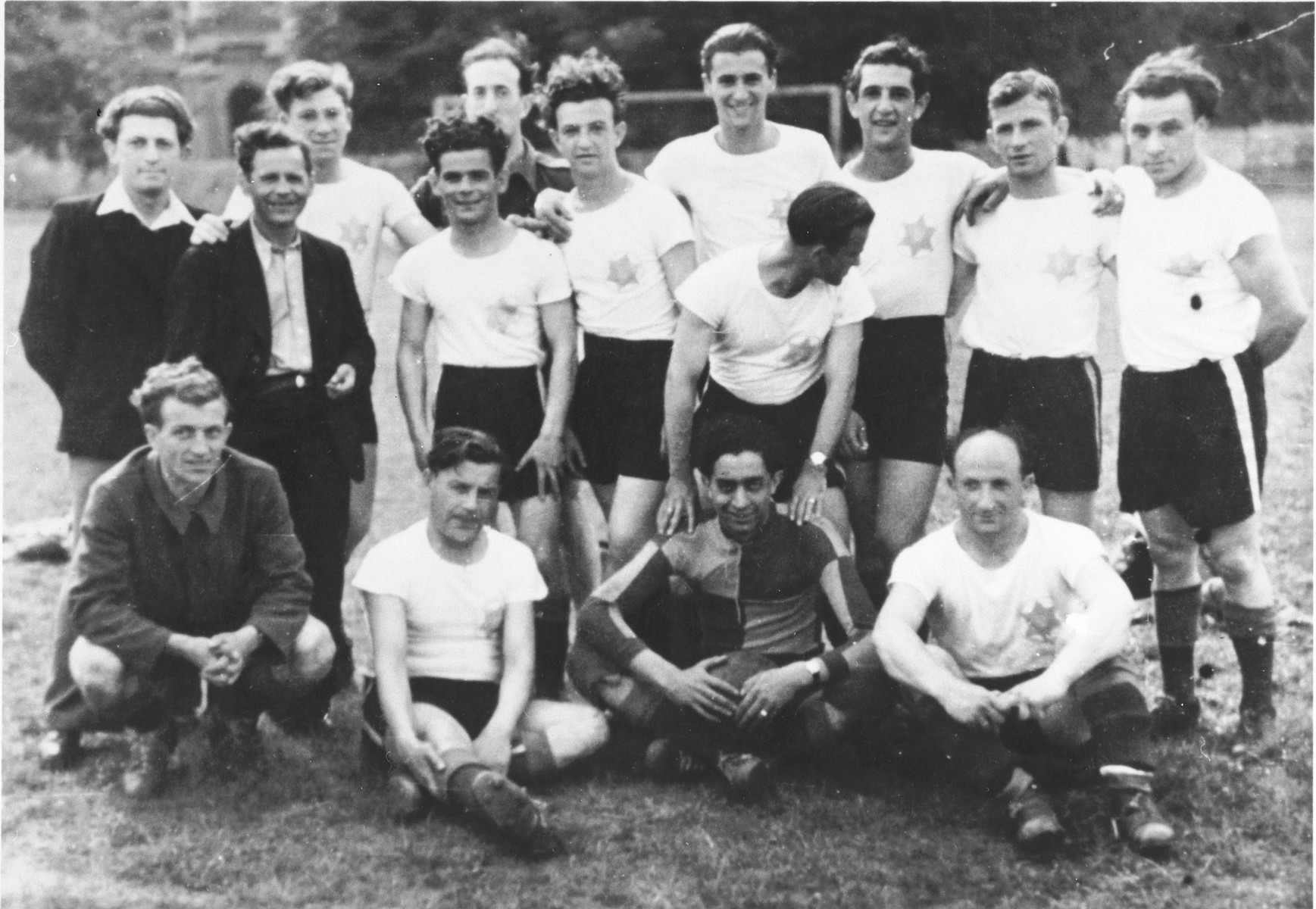 Auschwitz survivors, originally from Sighet, gather for a soccer game in a German DP camp.  Those pictured include Alex Kahn, back row, fourth from the right.