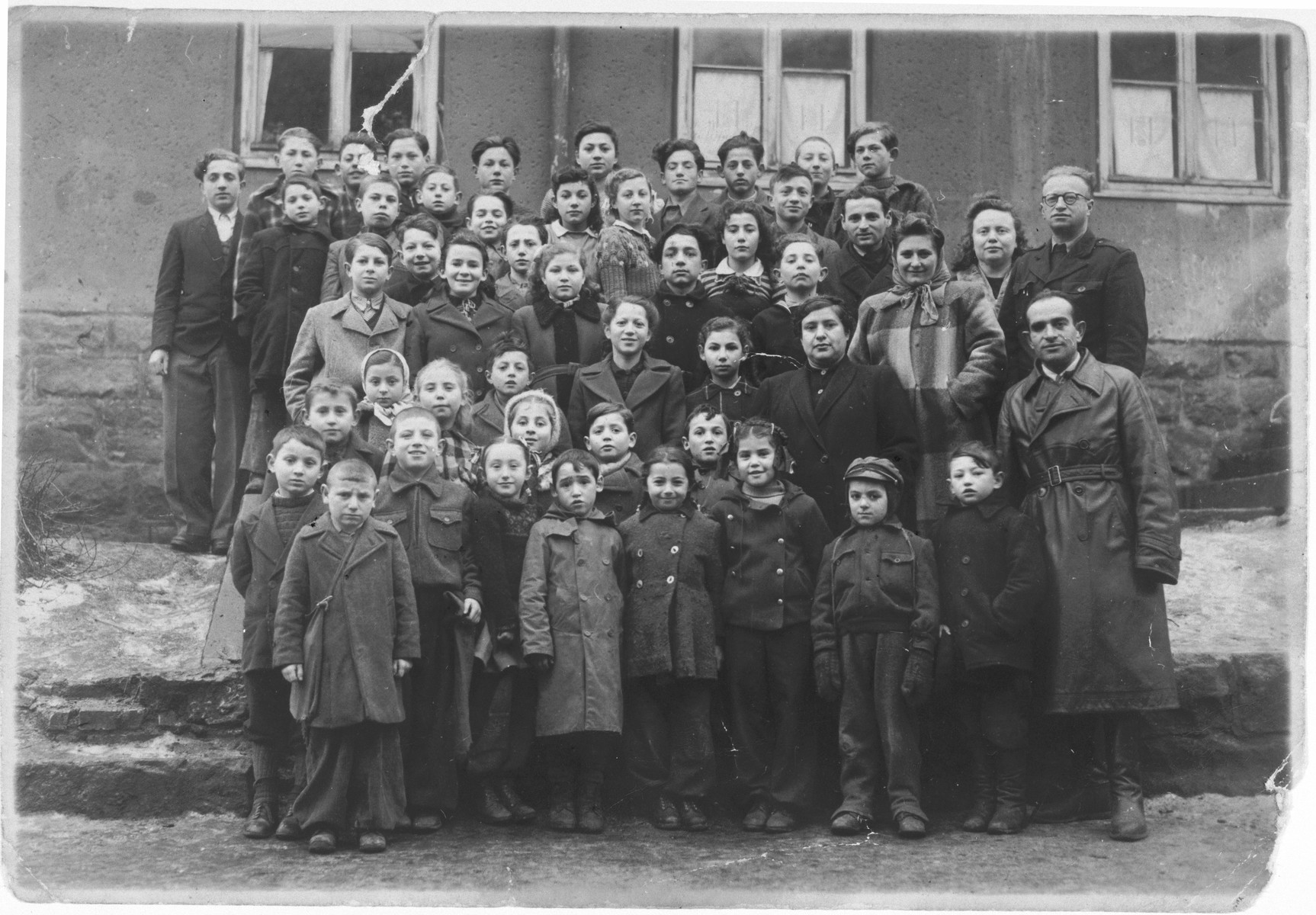 Children and teachers in the Tarbut school in the Rochelle displaced persons' camp.
